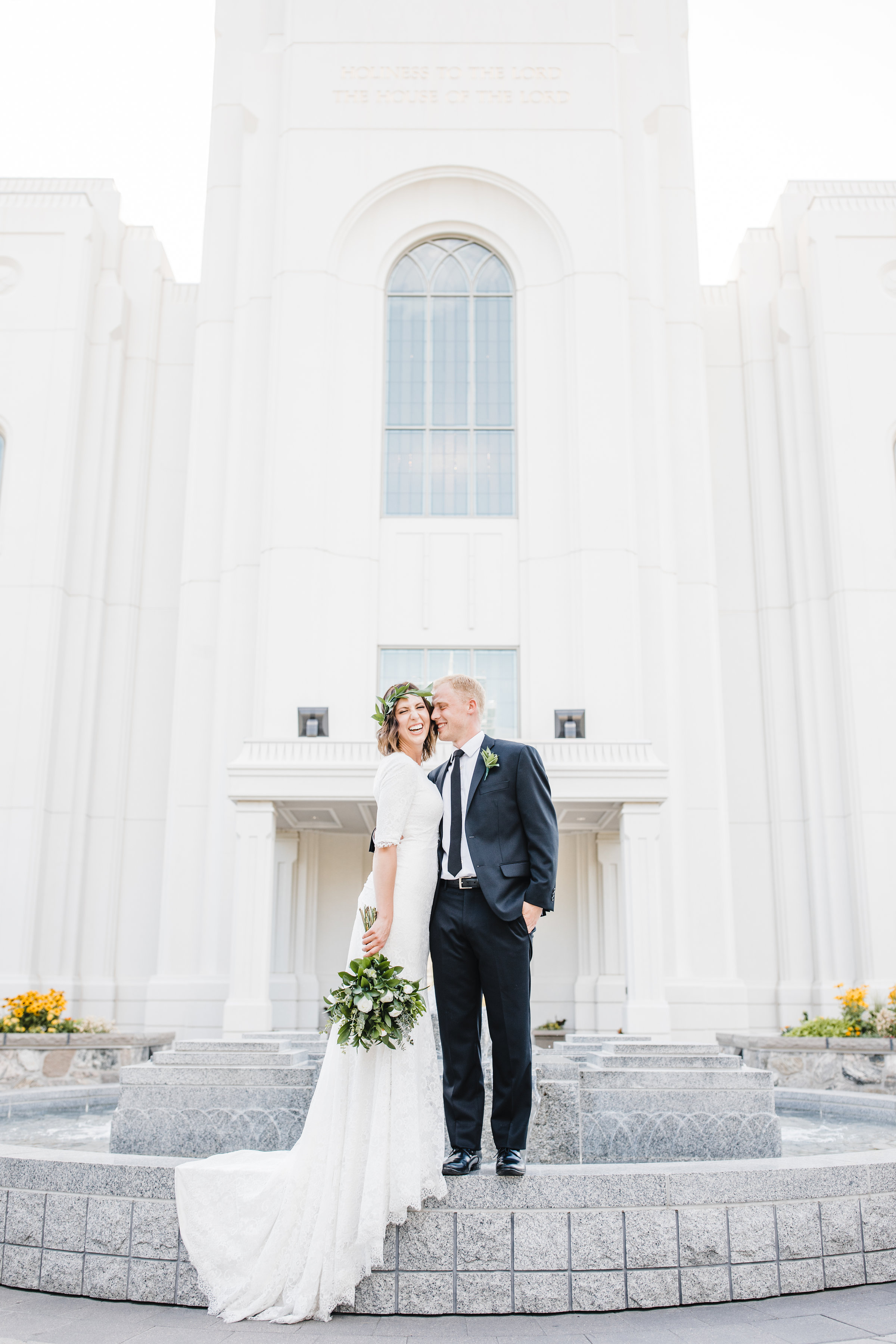 wedding photographer in brigham city utah lds temple floral crown white flowers happy laughing fountain