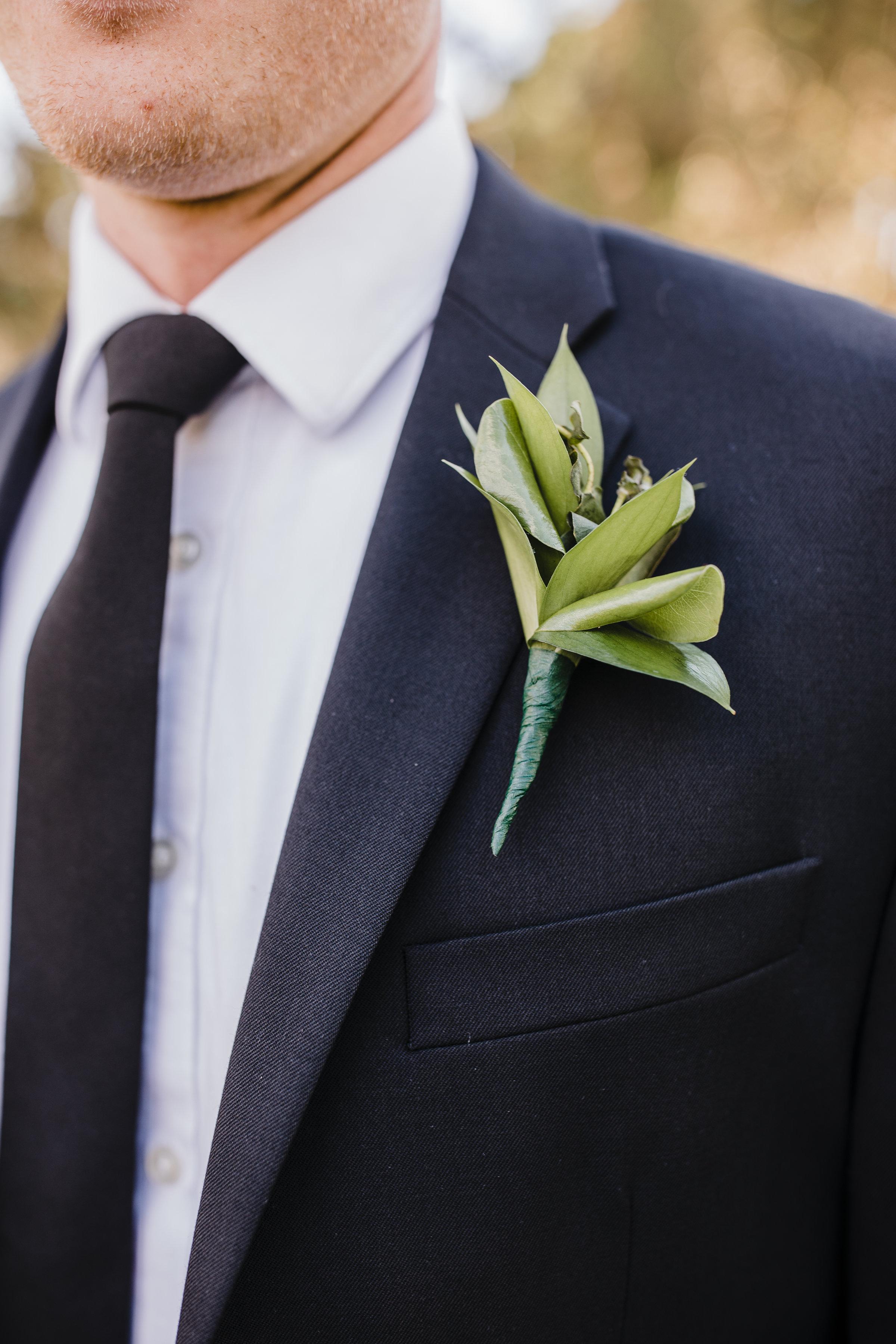 best photographer in brigham city utah botanical boutineer suit
