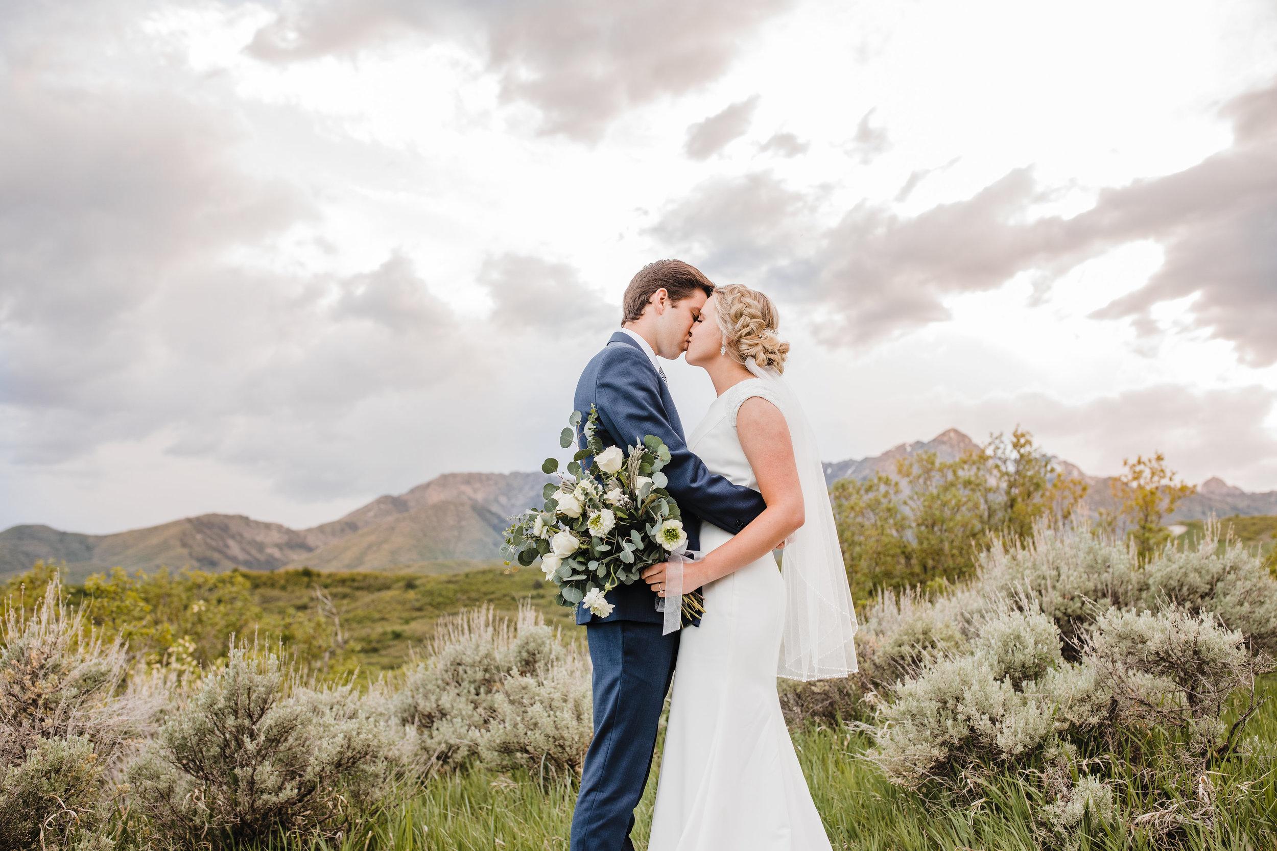 salt lake utah wedding photorgaphy stormy sunset mountains wildflower bouquet kissing