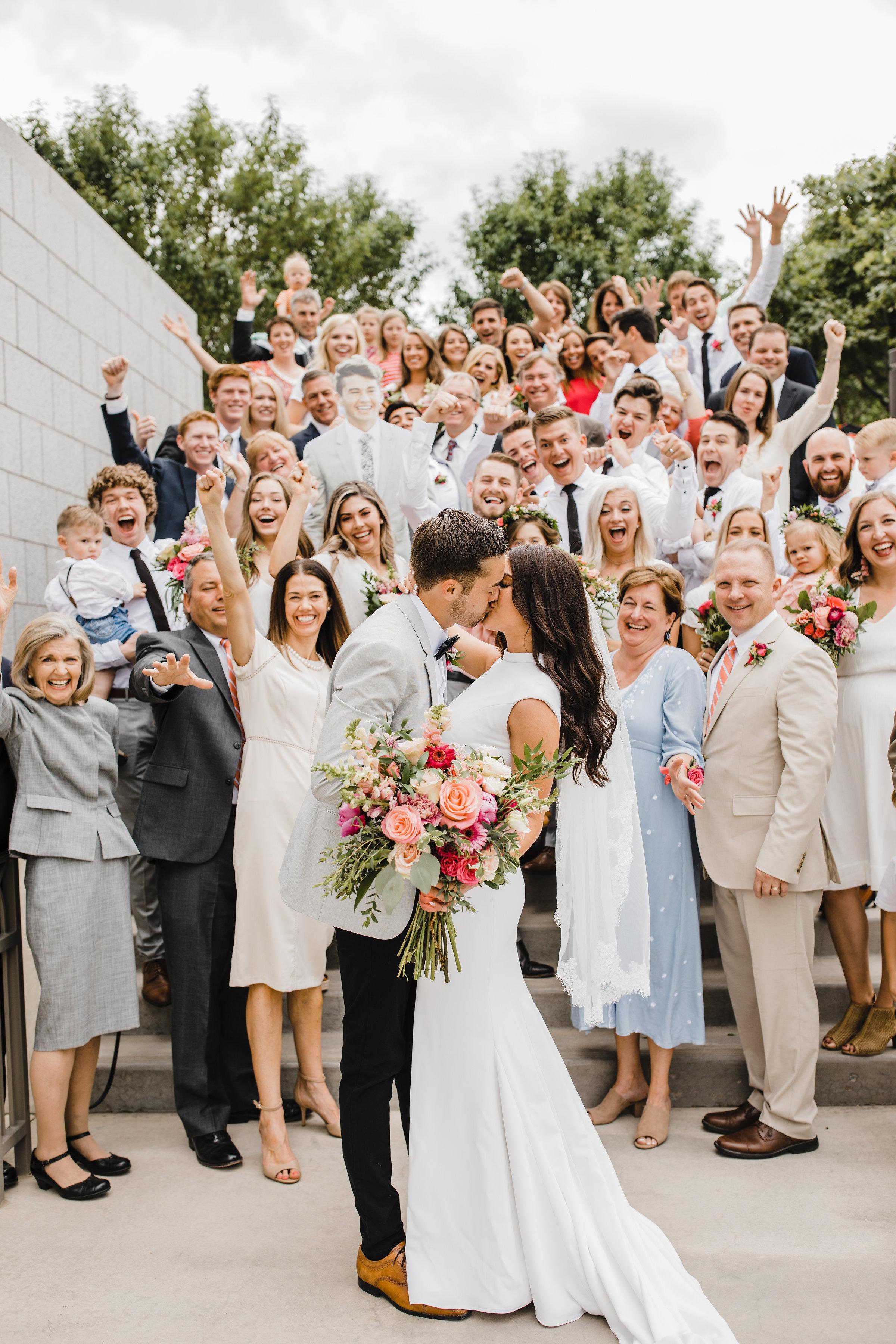 Draper utah wedding photographer wedding exit family cheering lds temple