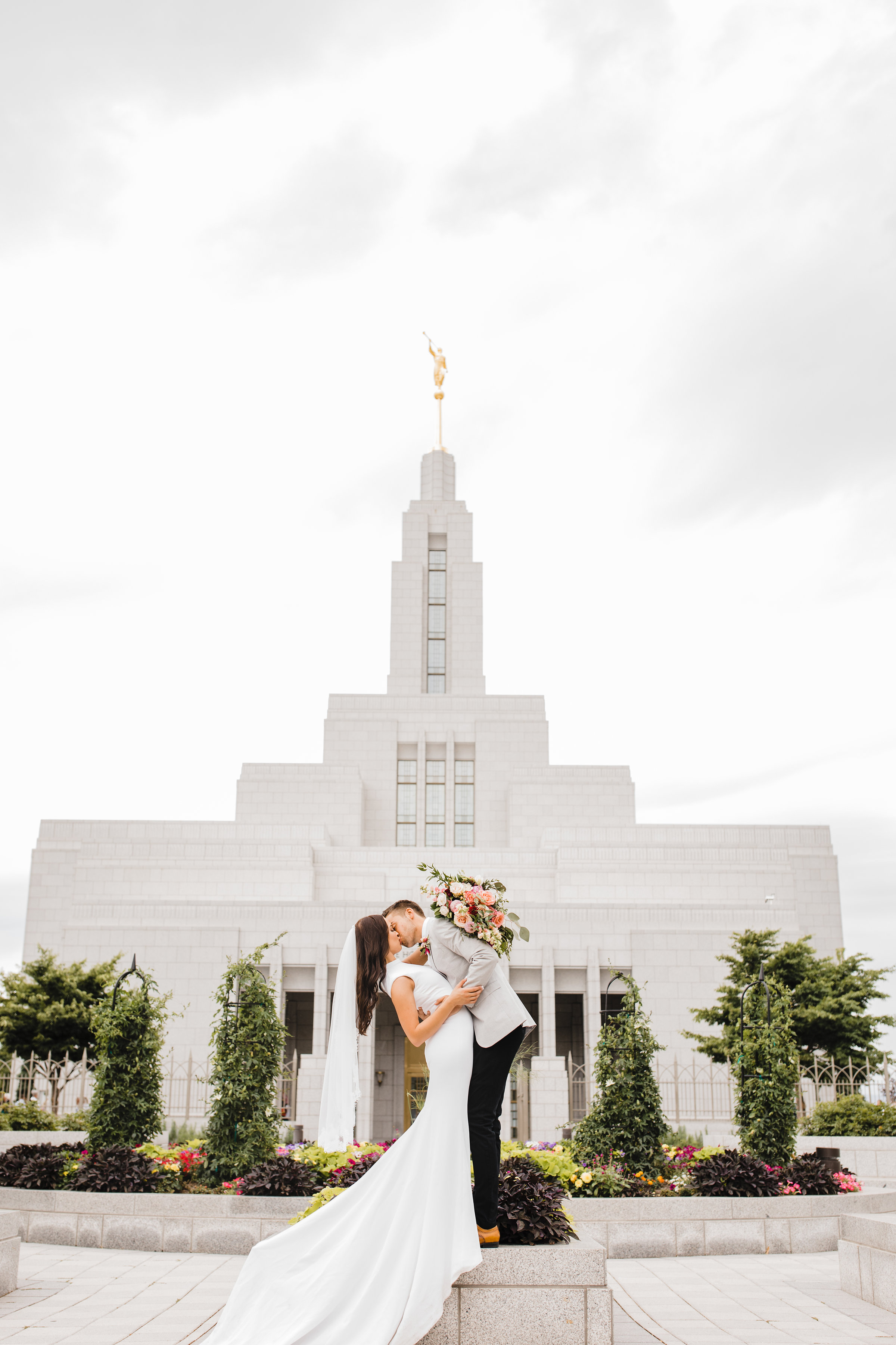 utah valley wedding photographer lds temple kissing dip
