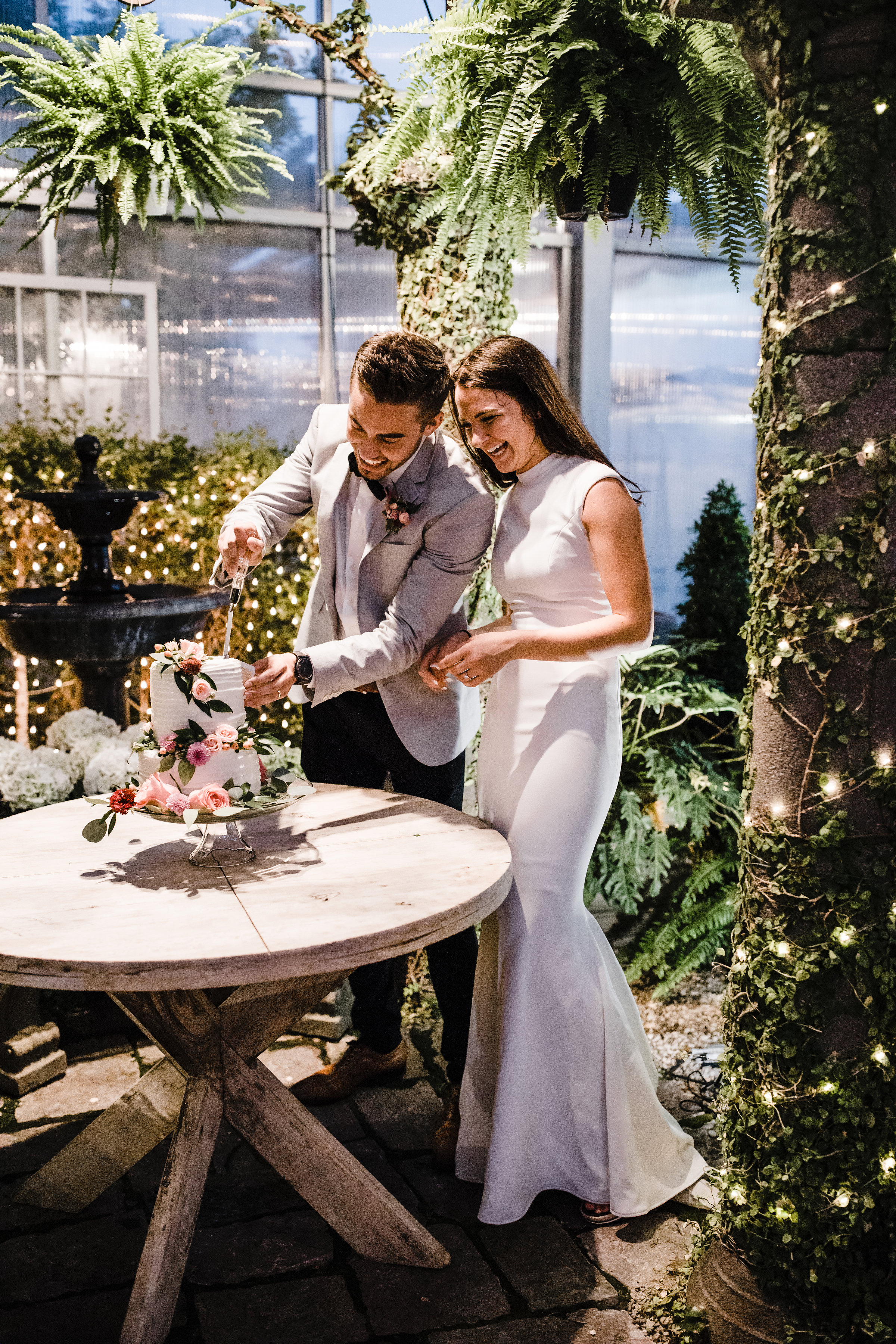 draper wedding reception photographer cutting cake smiling botanicals