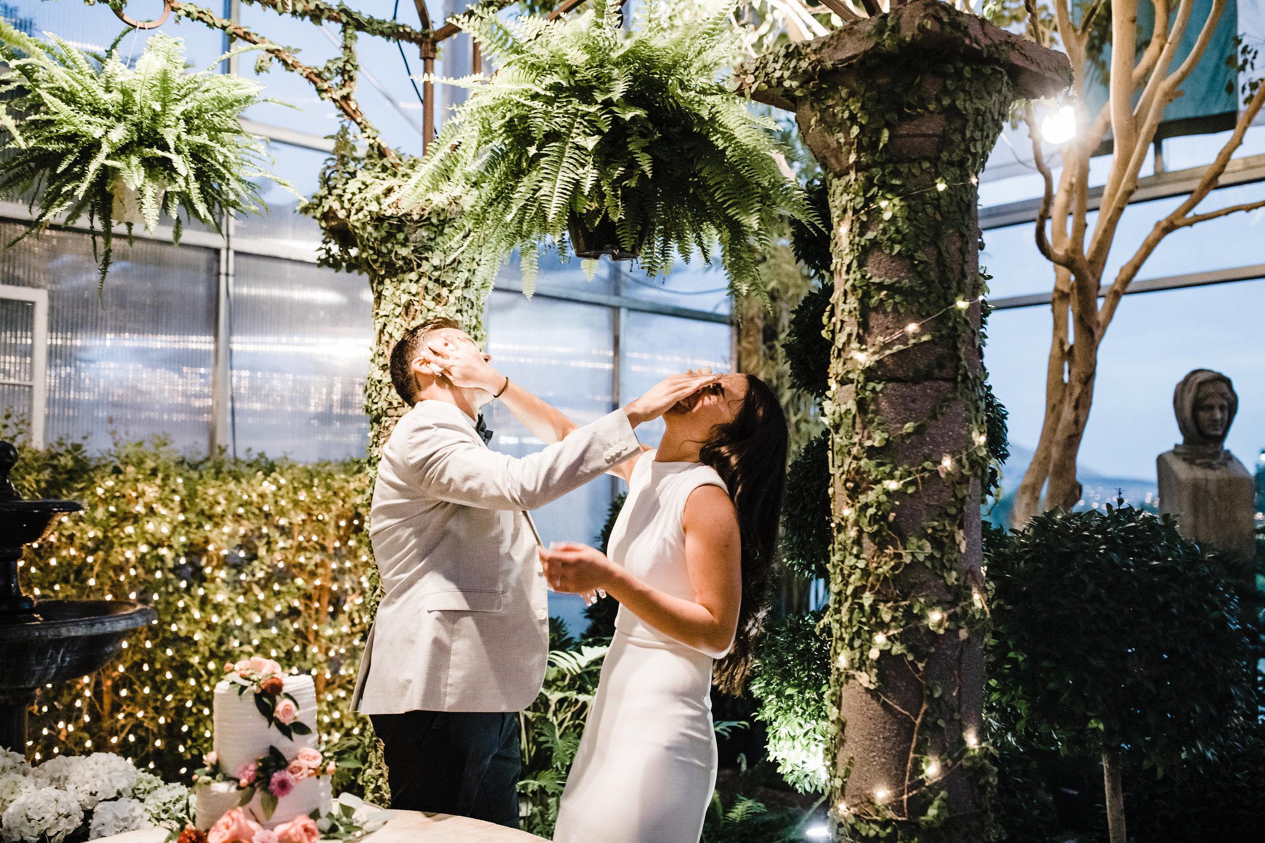 utah valley wedding photographer reception cake smash laughing
