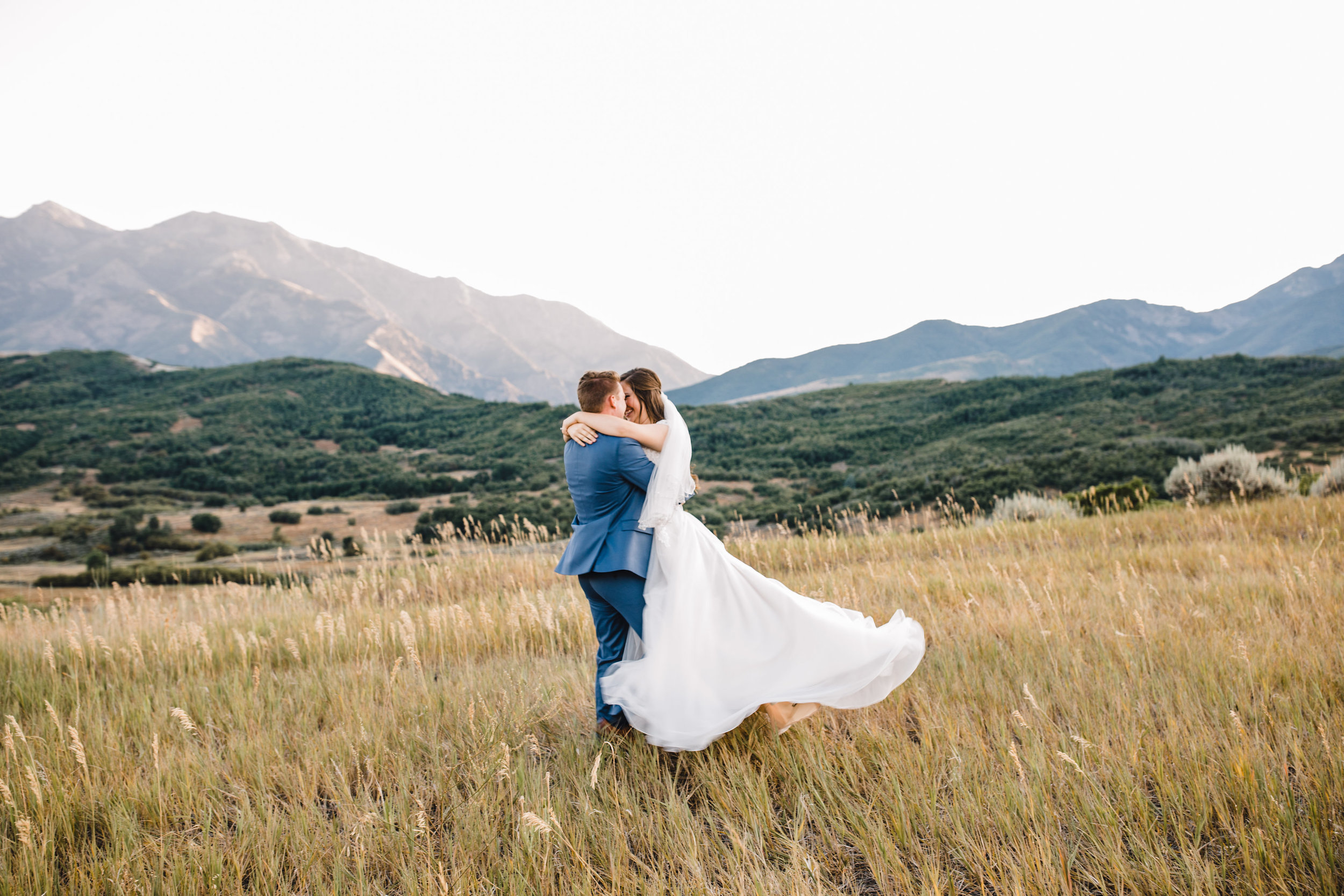 Cache valley utah photographer bridals formals spinning hugging field mountains