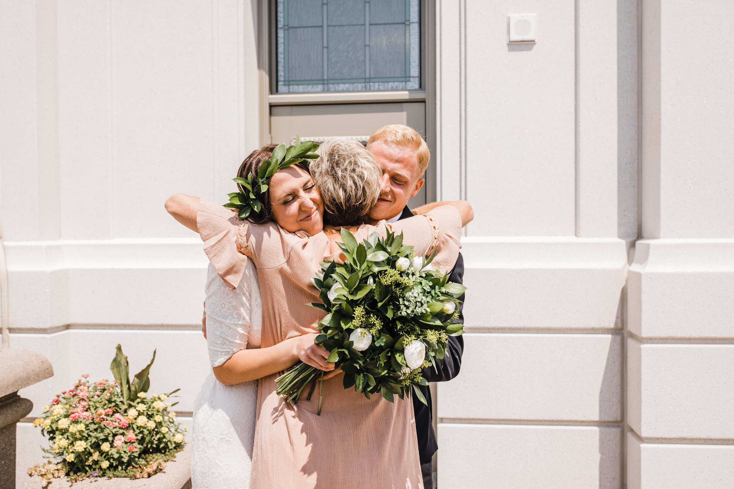 brigham city wedding photographer wedding exit hugging mother in law smiling