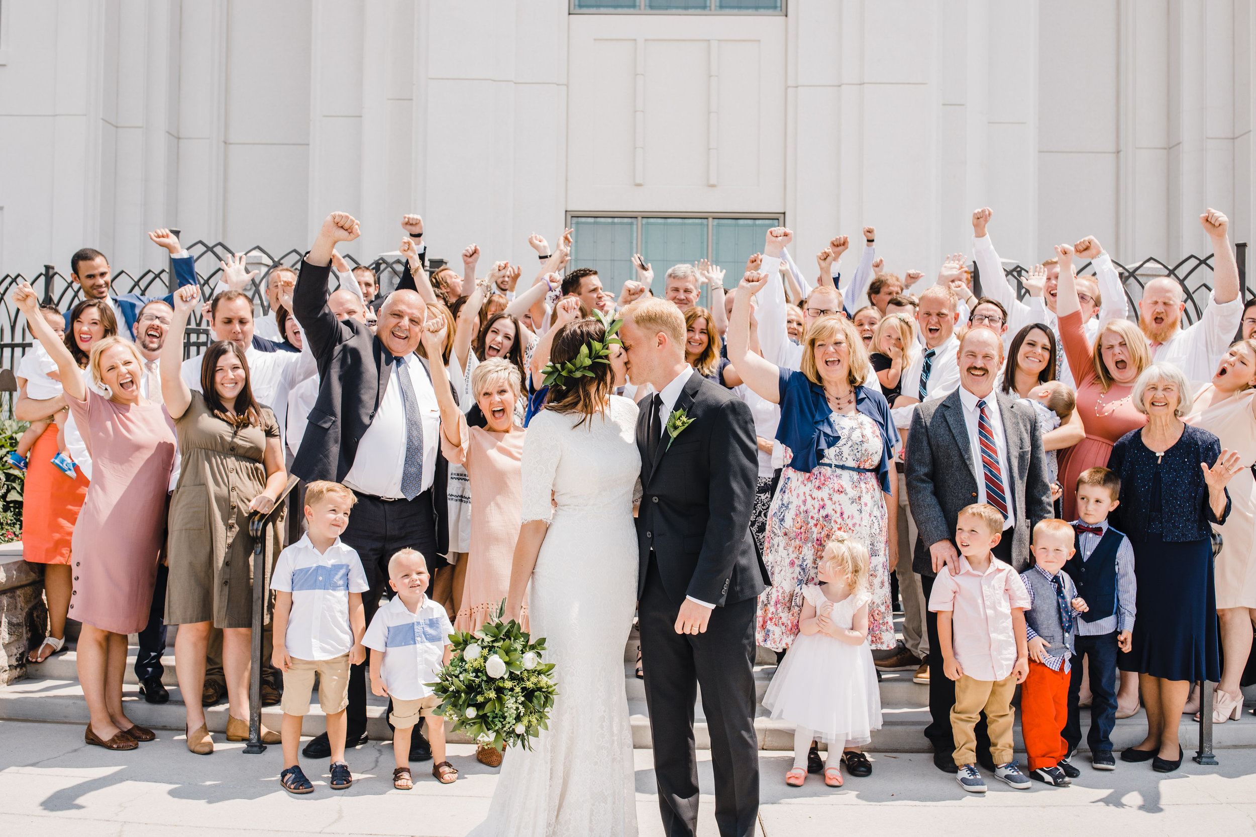 brigham city wedding photographer temple exit lds cheering family happy kissing