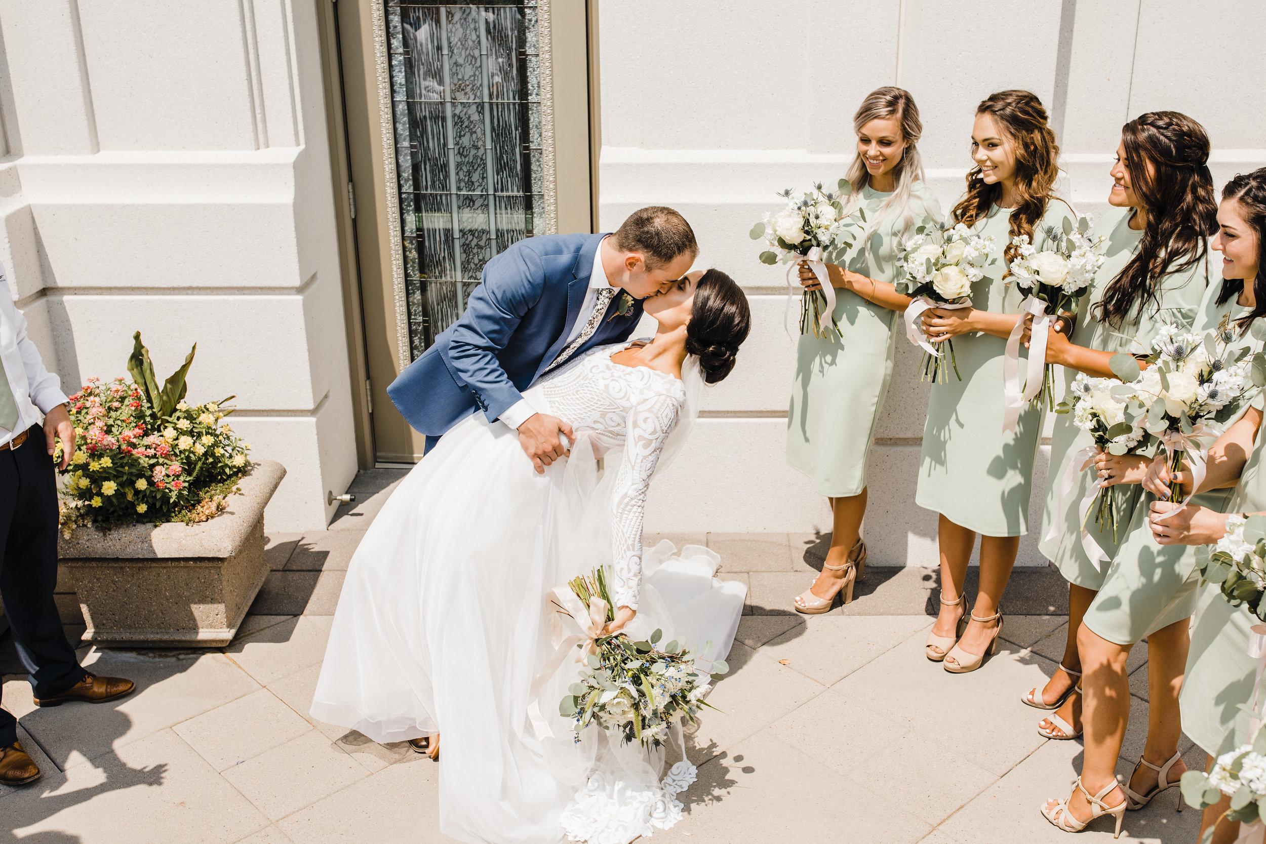 brigham city utah wedding photographer lds temple exit dip kissing cheering happy