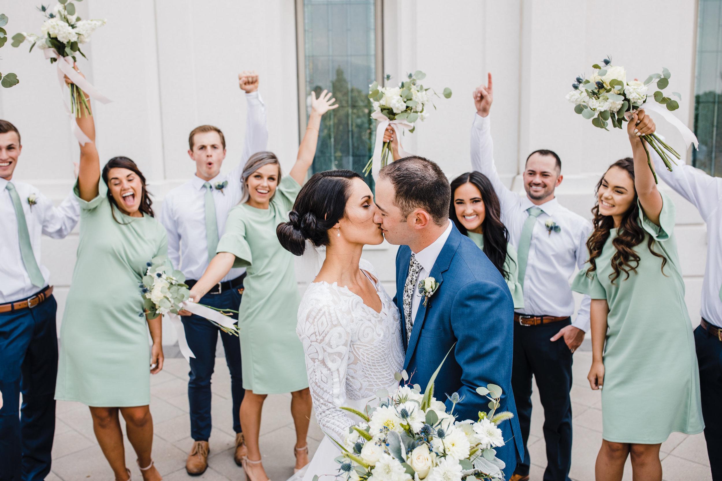 brigham city utah wedding photographer bridal party groomsmen green bridesmaids dresses cheering kissing romantic