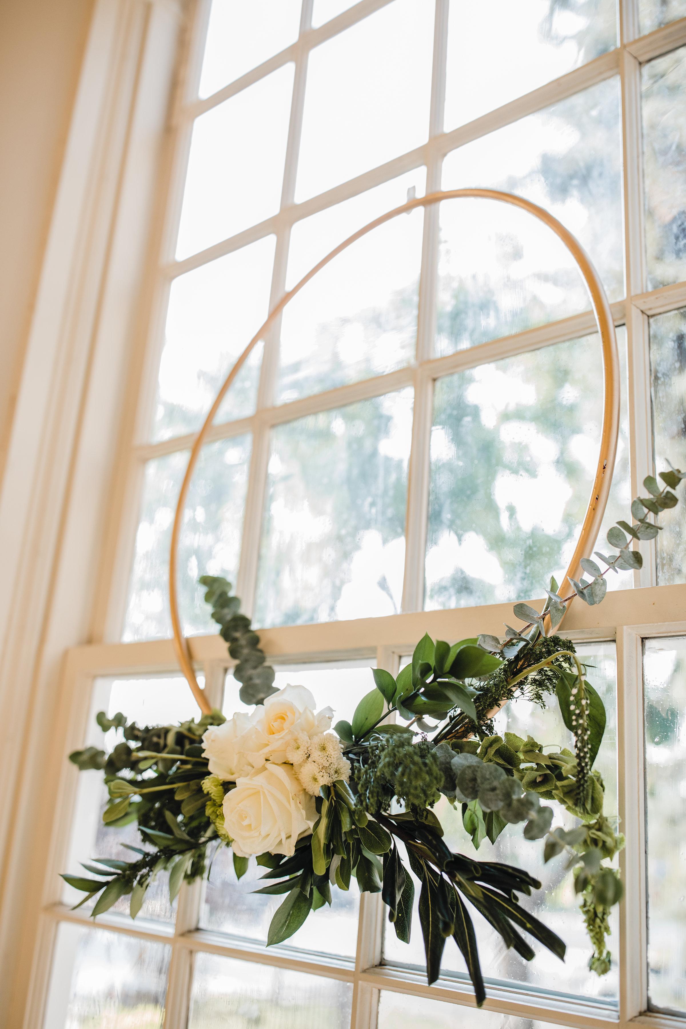 brigham city utah wedding photographer reception white floral arrangement windows