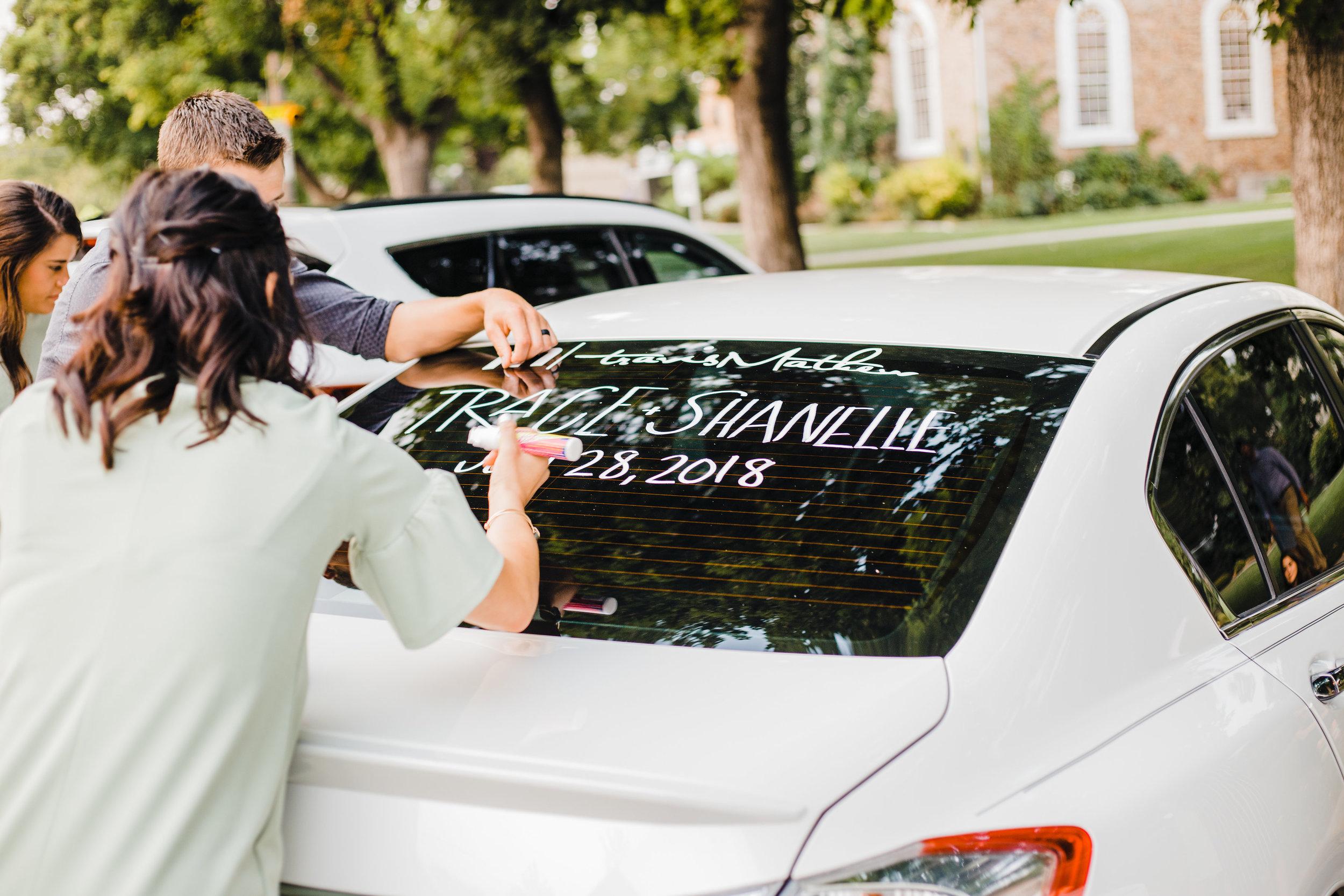 brigham city utah wedding photographer decorating getaway car