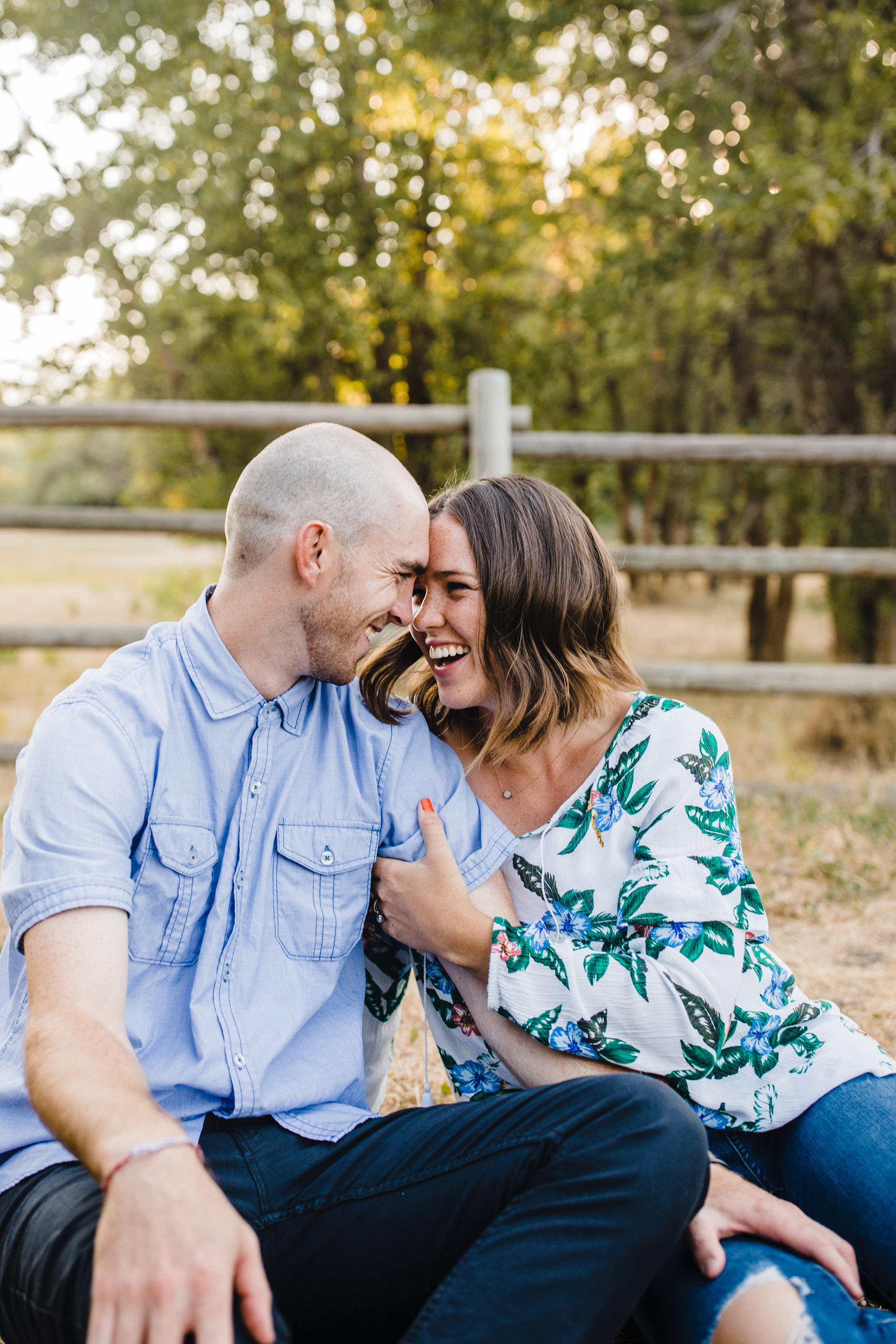 logan utah couples photographer smiling laughing hugging