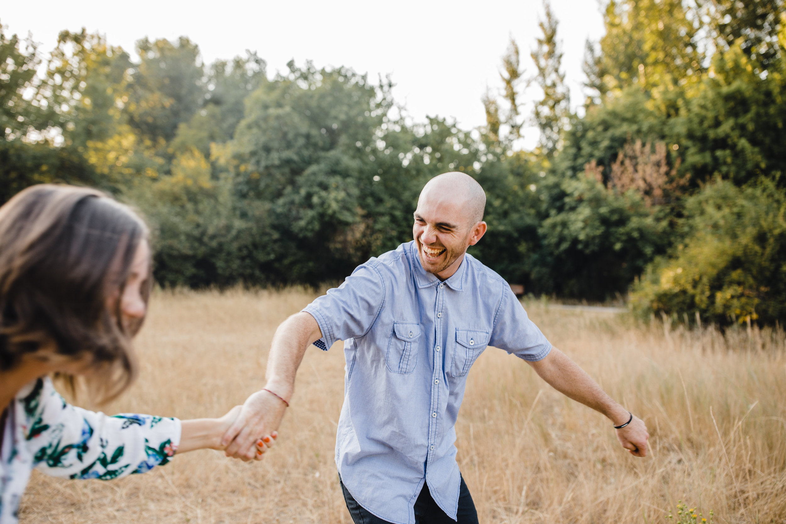 couples photographer in logan utah walking laughing spinning holding hands