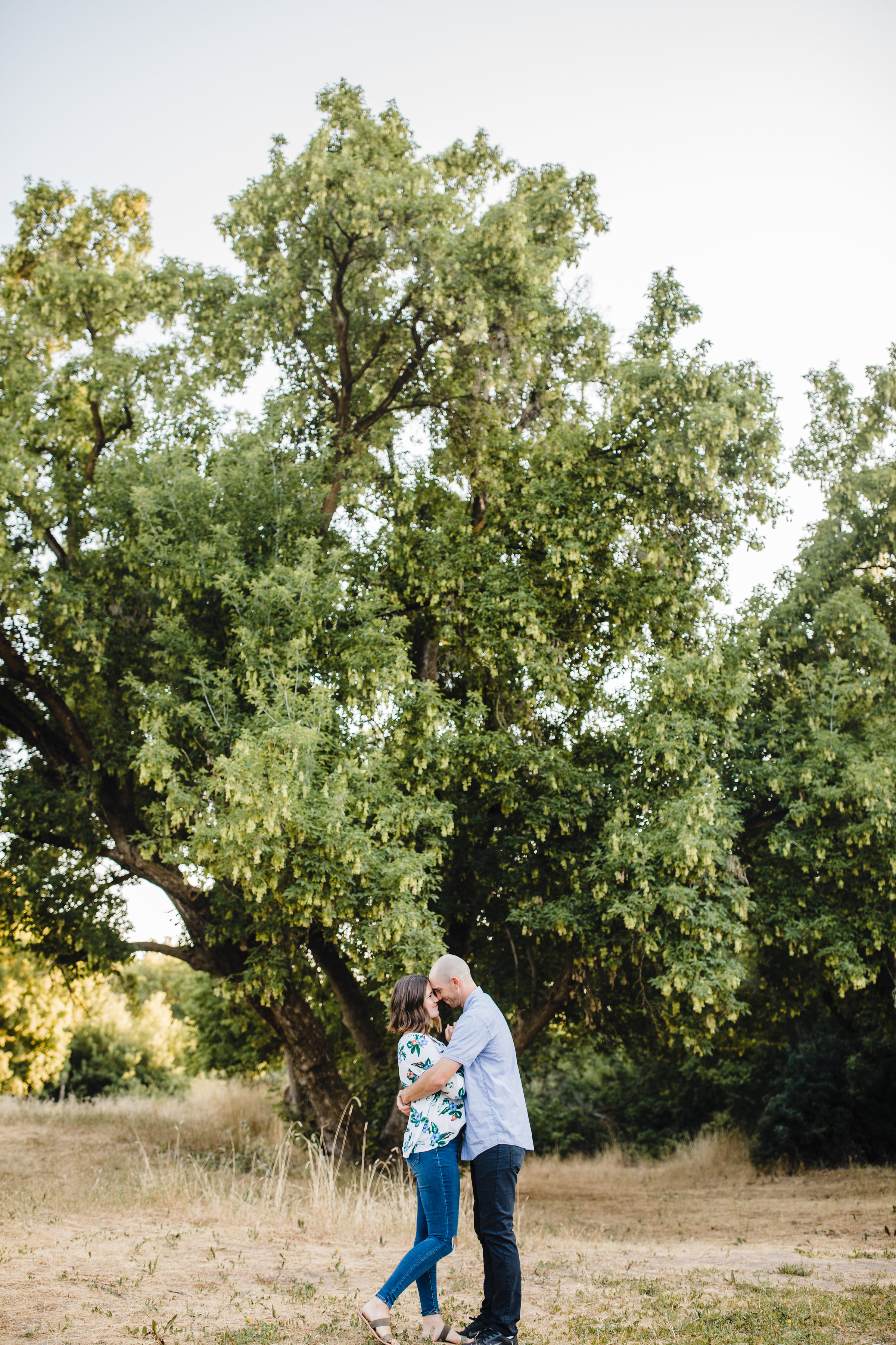 cache valley utah couples photographer smiling holding hands trees hugging