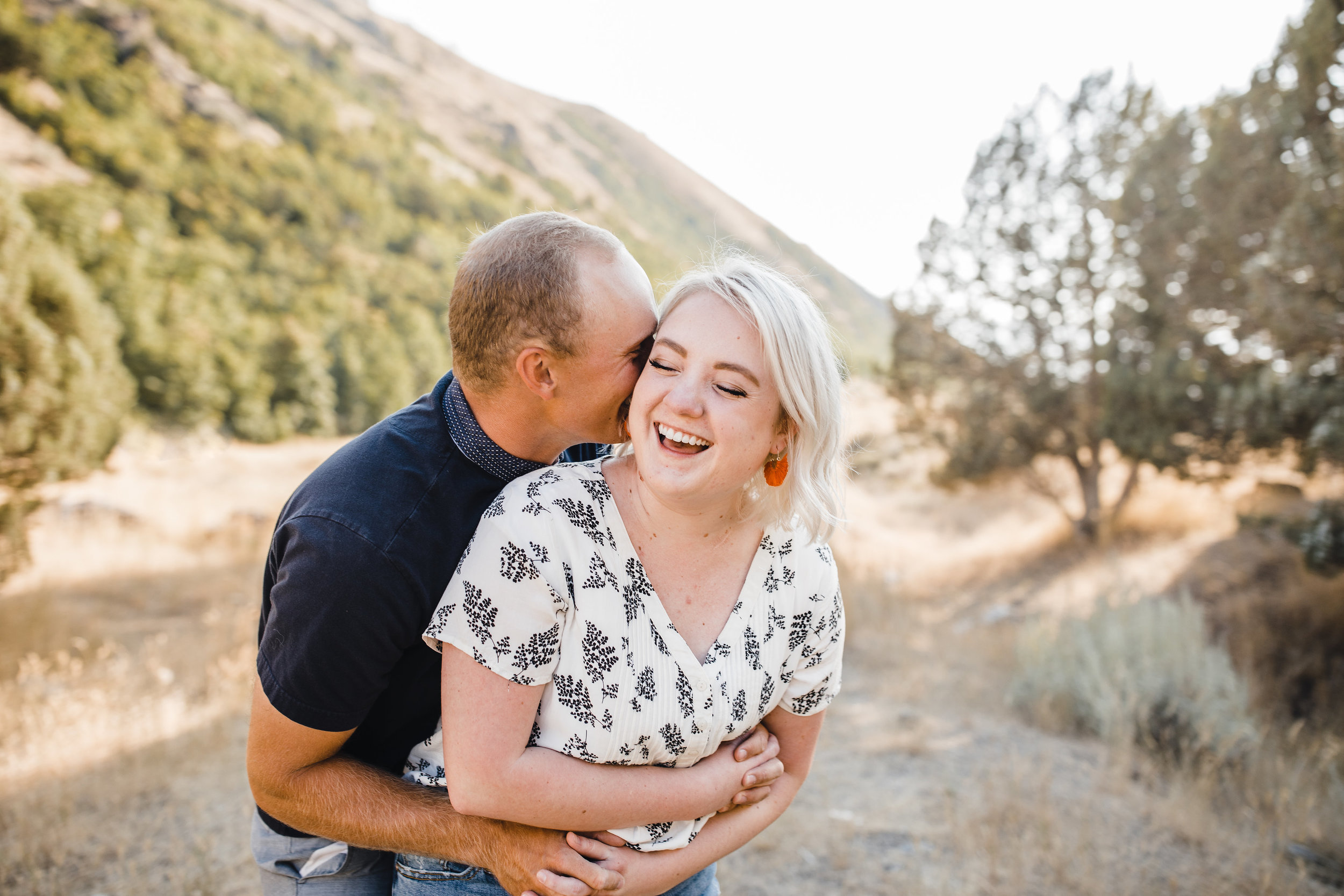 best logan utah couples photographer laughing hugging playful