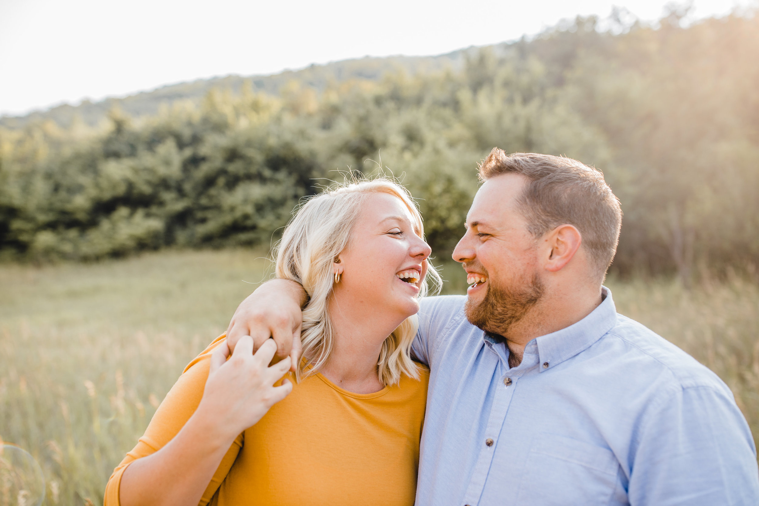 brigham city utah engagement photographer best marigold dress laughing hugging mountain backdrop