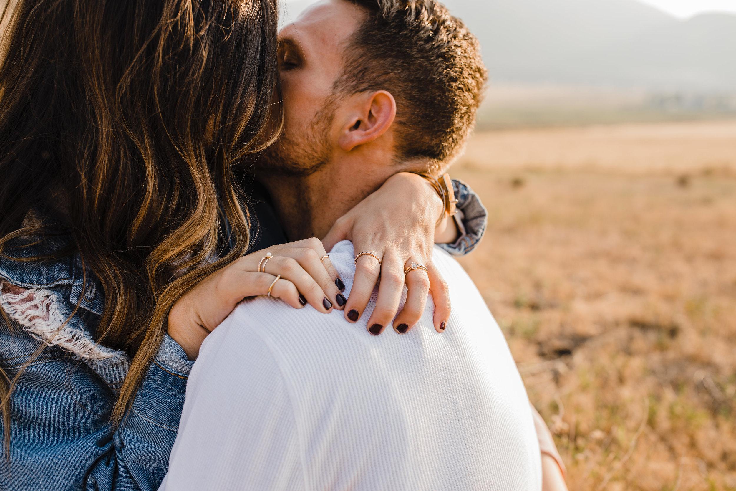 professional mantua utah couples photographer hugging rings black finger nails