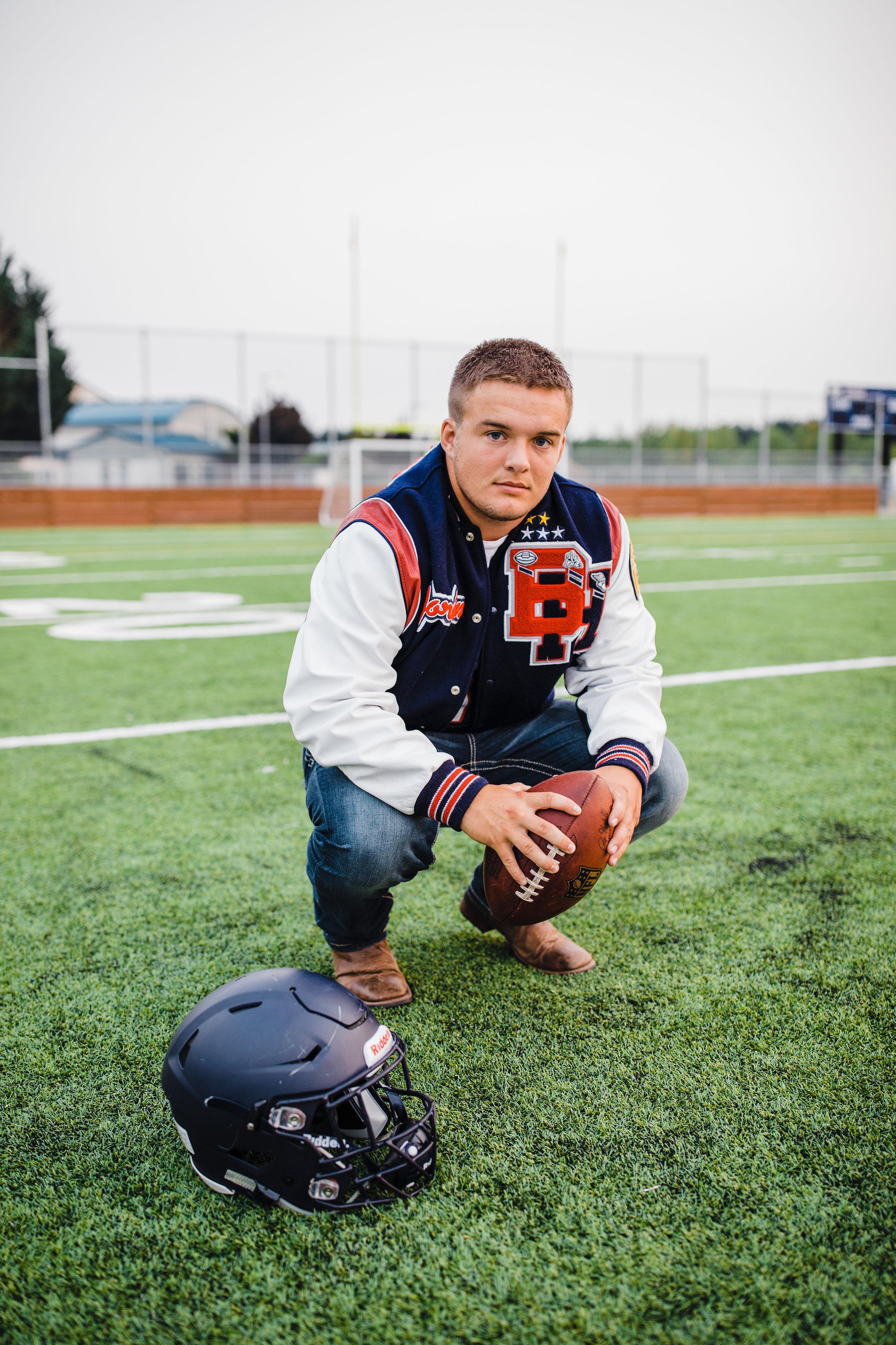 professional senior photographer football field leatherman jacket football helmet