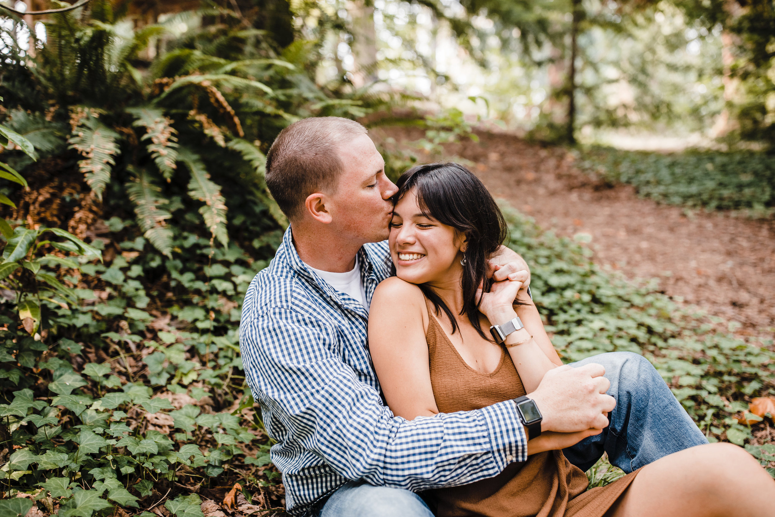 professional engagement photographer in olympia washington sitting cuddling smiling