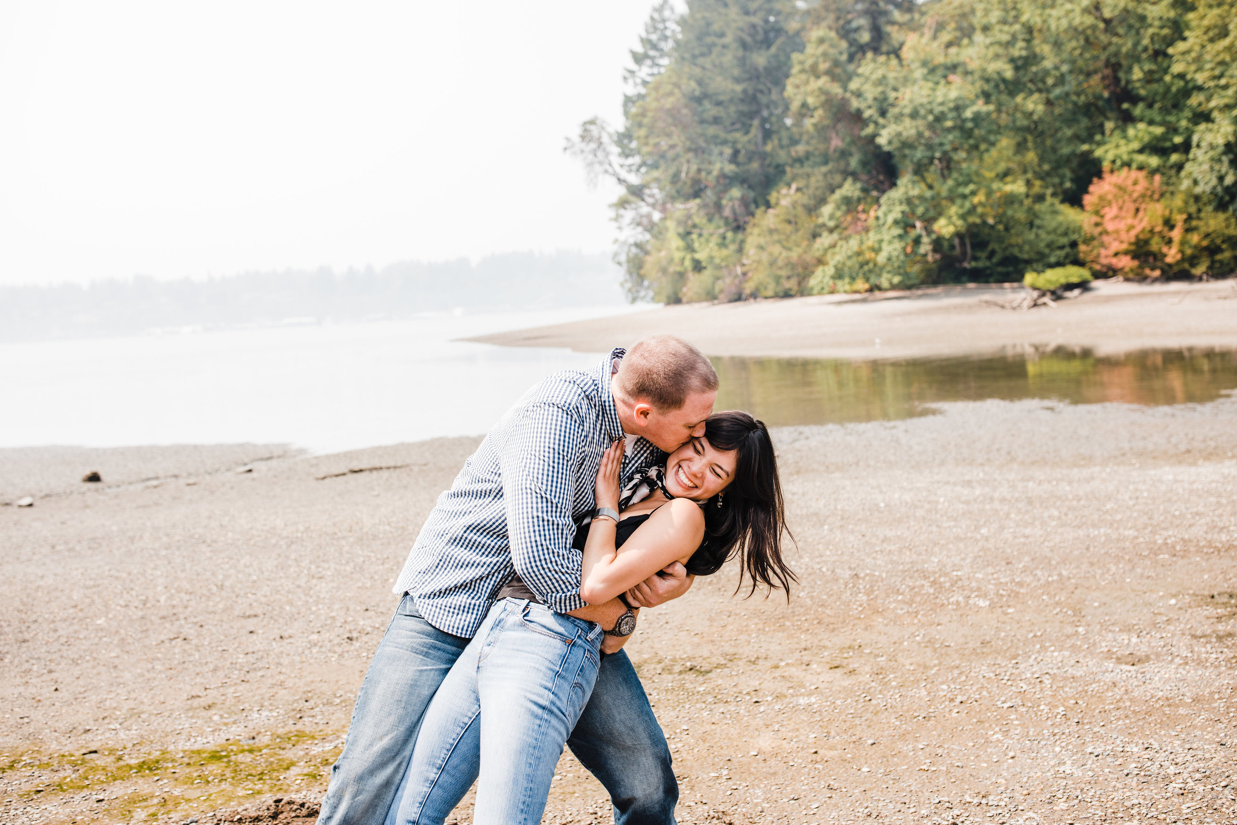 best professional engagement photographer in olympia washington beach smiling playful kissing hugging