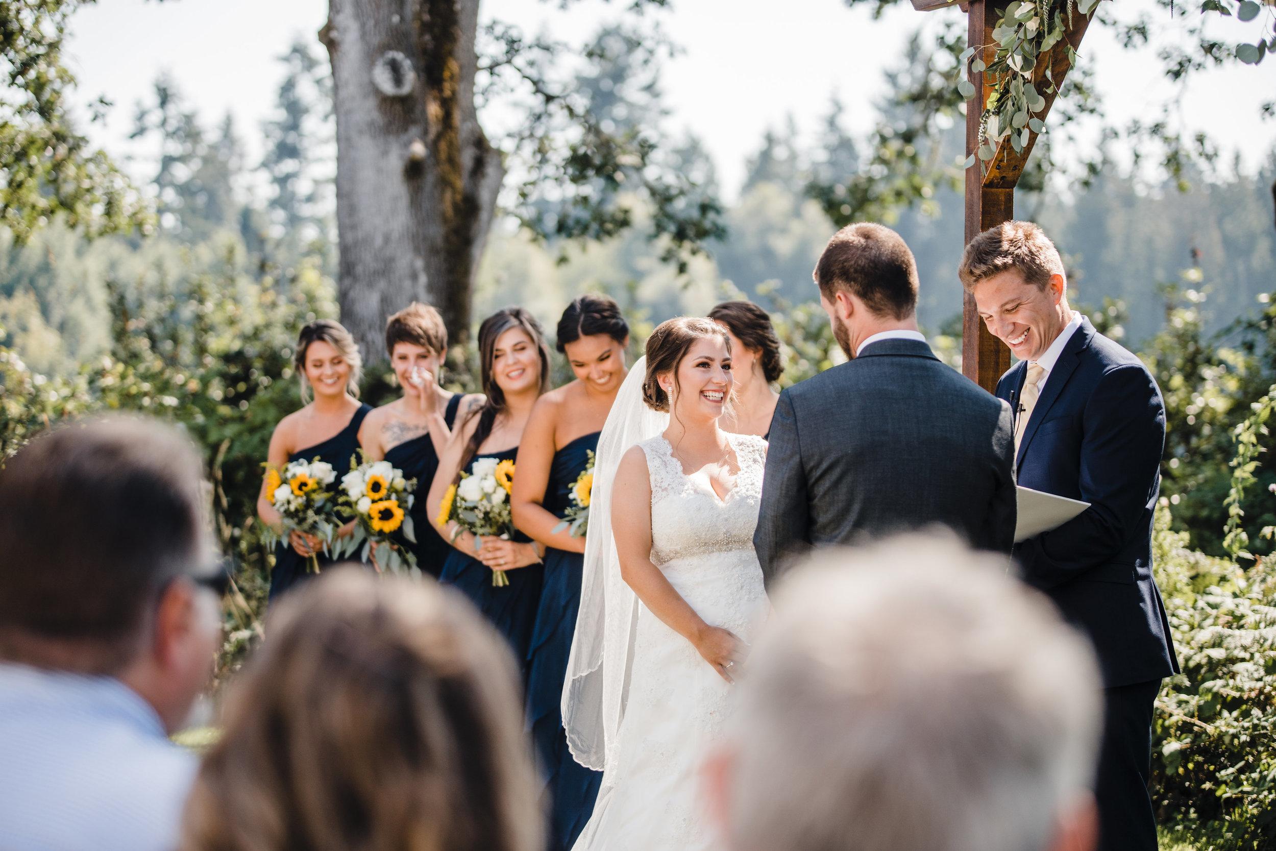 olympia washington professional wedding photographer wedding party wedding arch happy