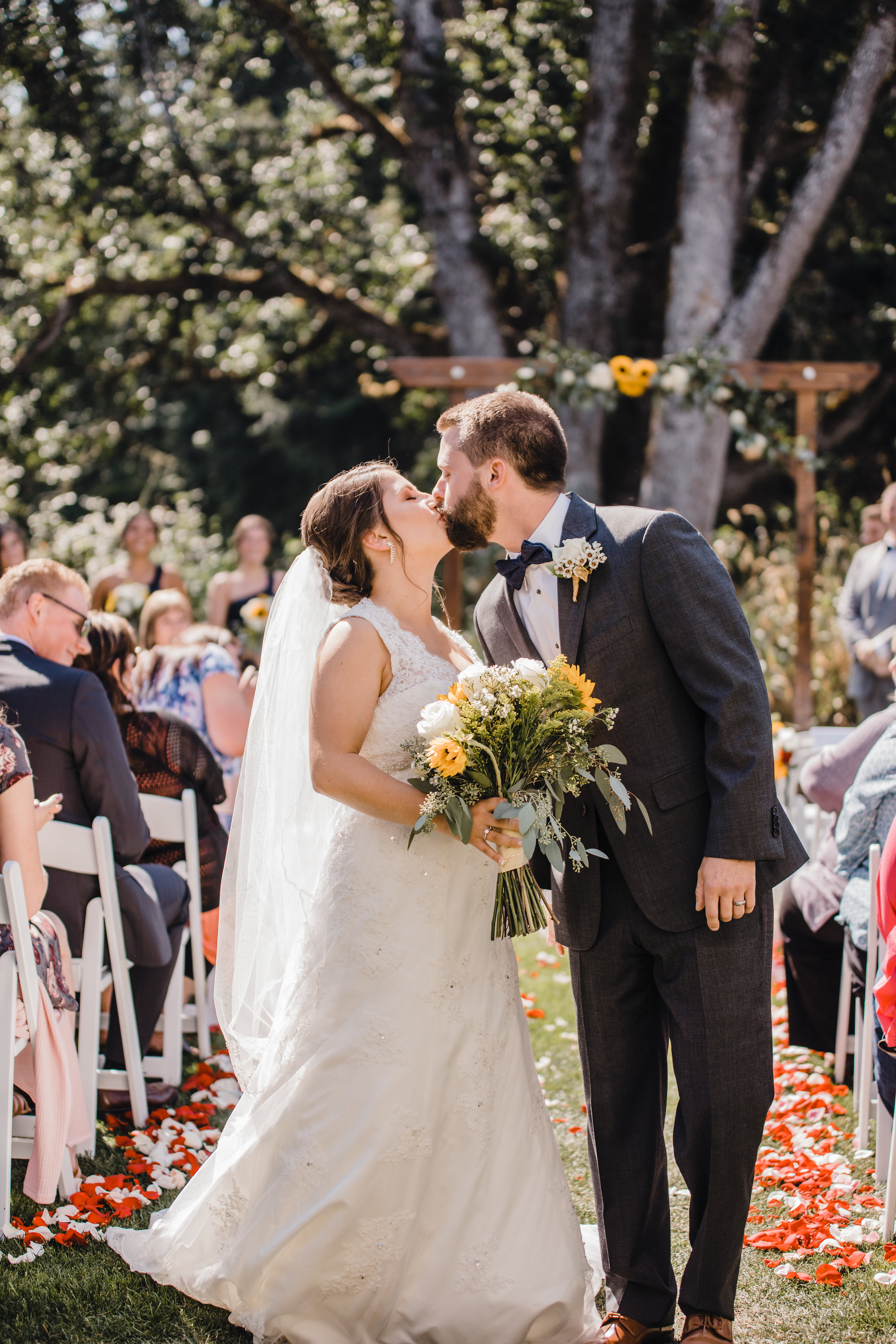 olympia washington professional wedding photographer outdoor wedding ceremony wedding exit kissing cheering happy