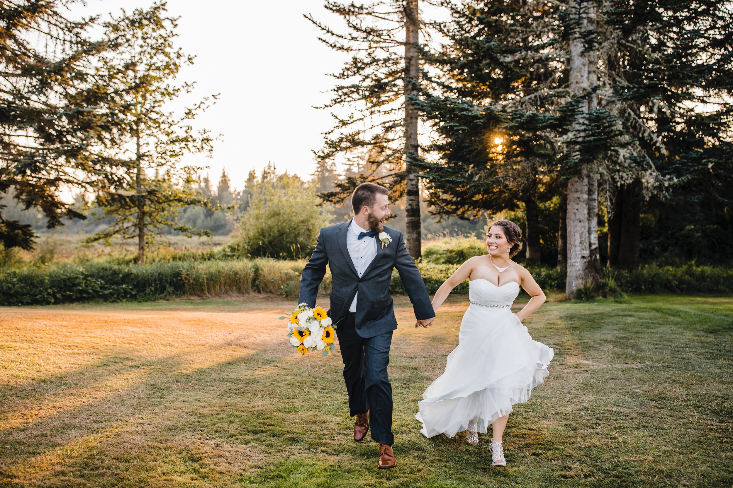 olympia washington professional wedding photographer running holding hands happy