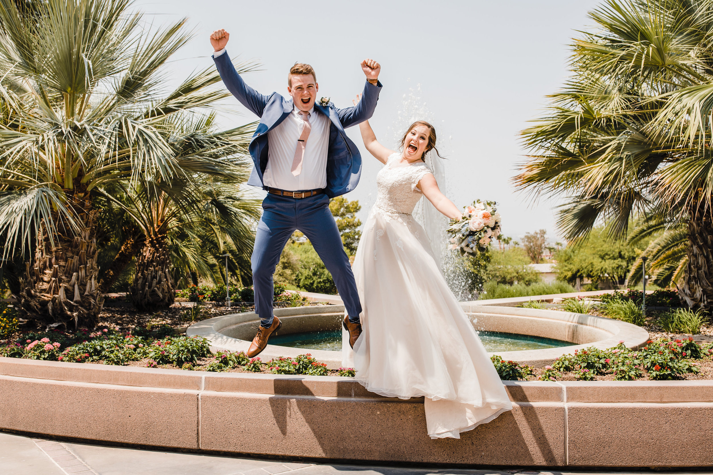 professional las vegas wedding photographer cheering jumping hands up