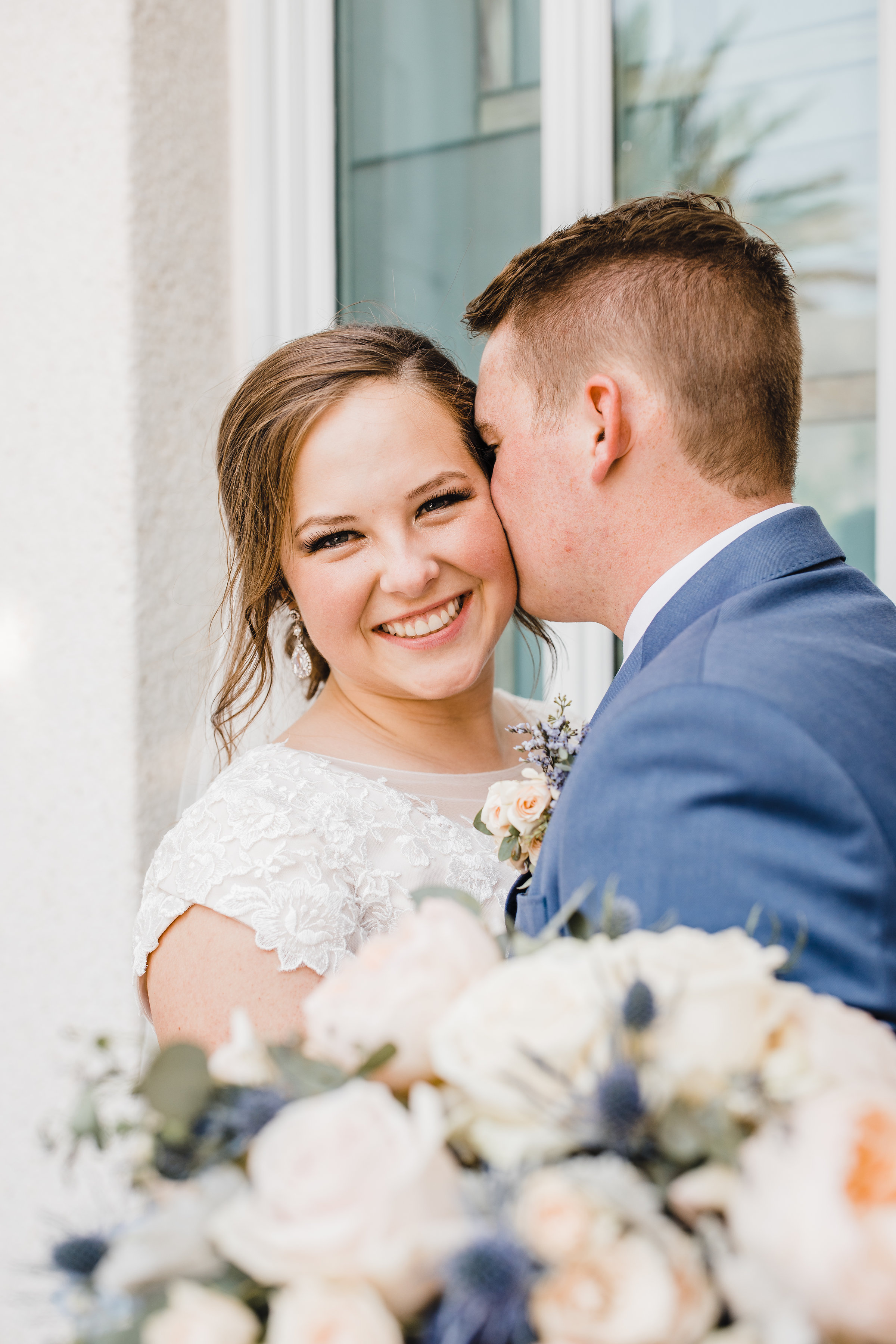 professional las vegas wedding photographer smiling hugging lds temple kissing happy
