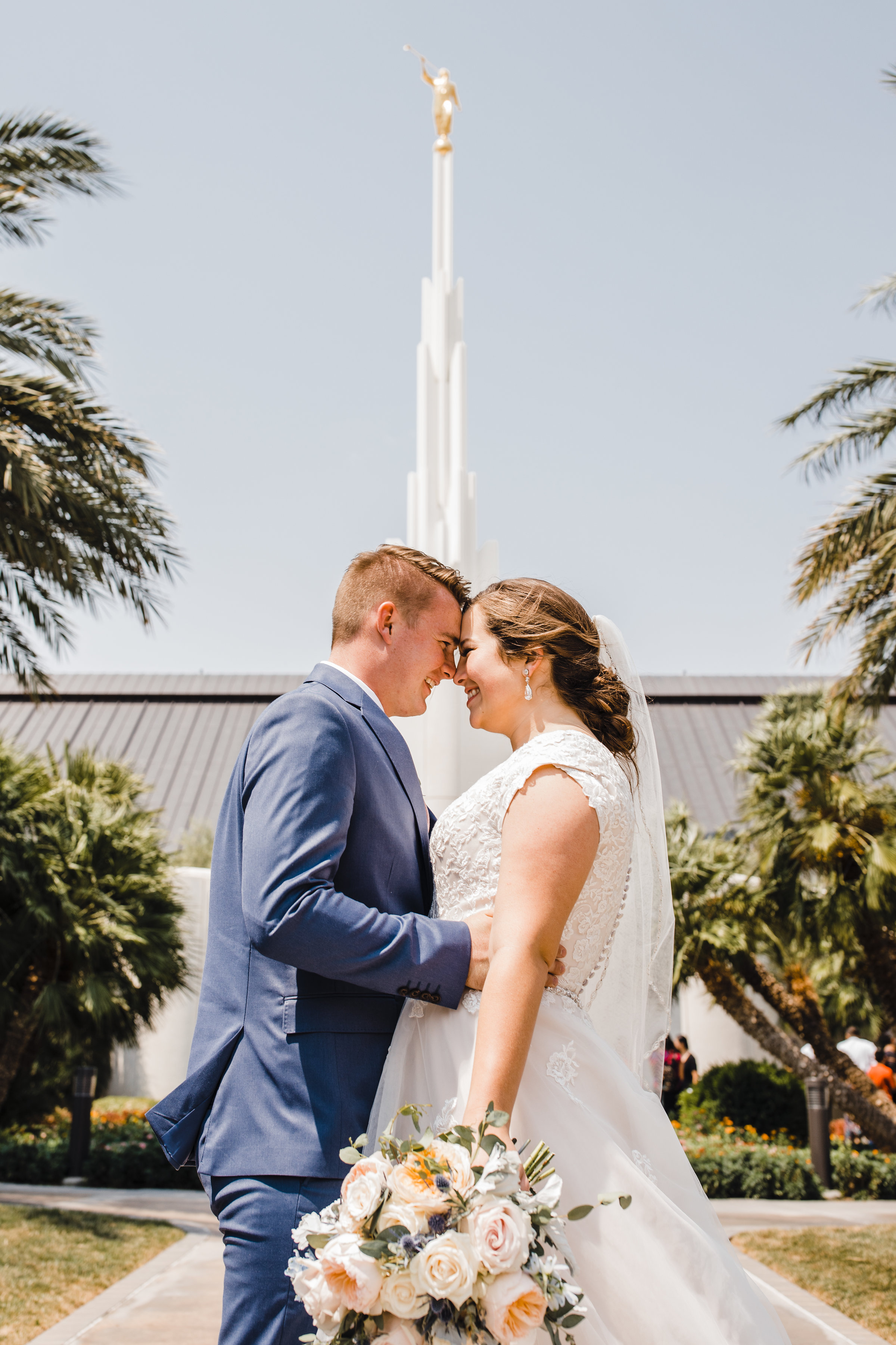 professional las vegas wedding photographer lds temple hugging laughing smiling