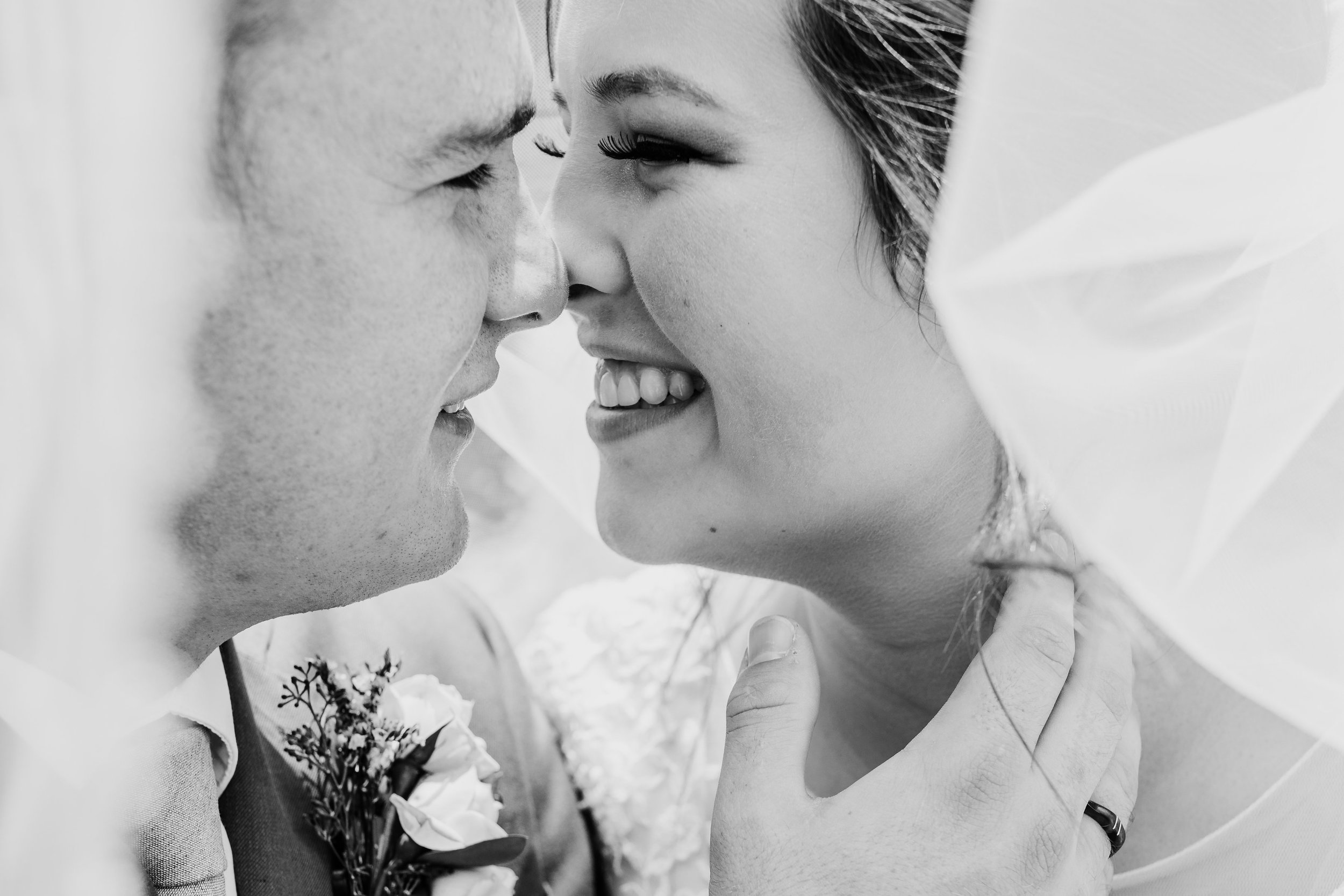 professional las vegas wedding photographer veil laughing playful touching noses