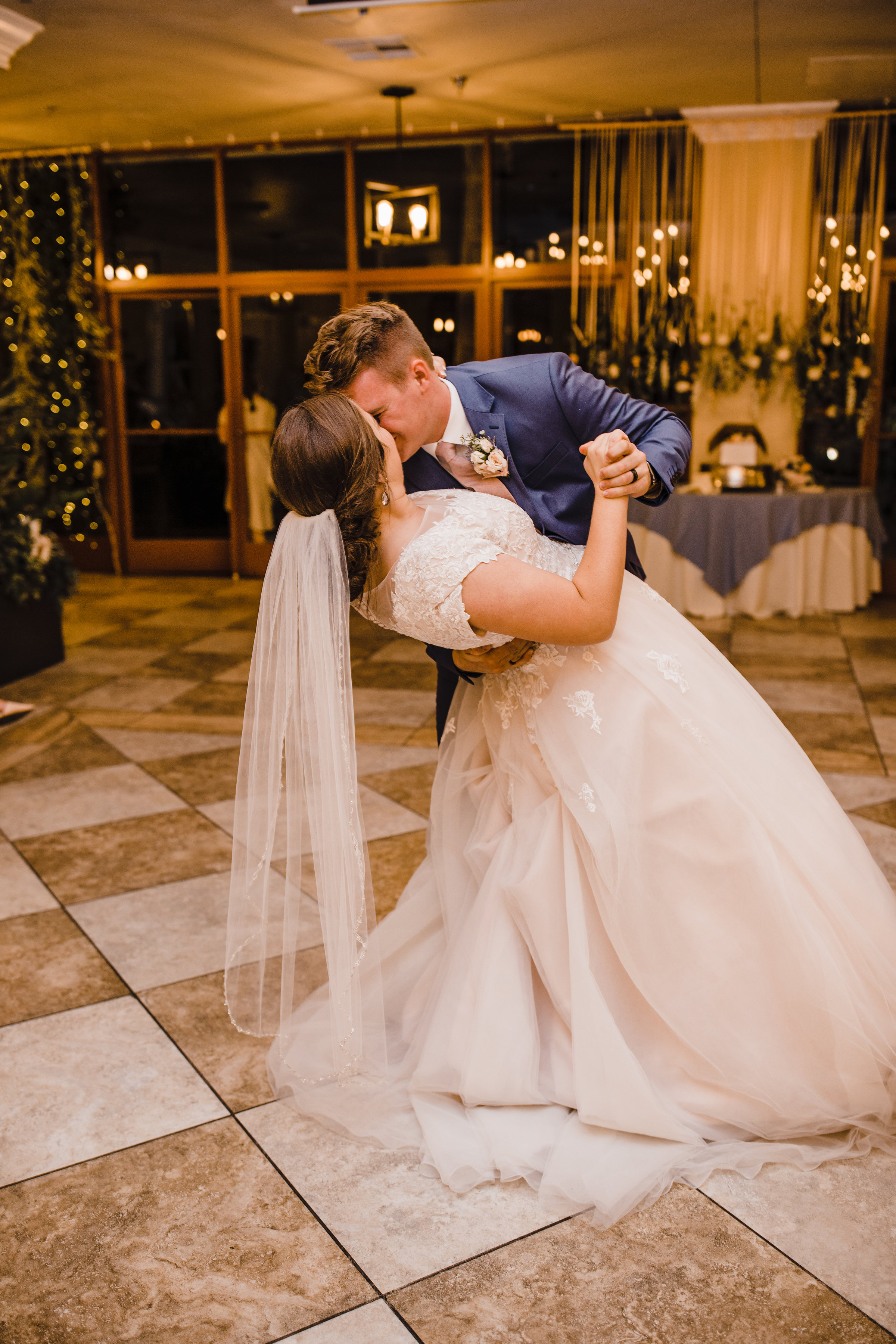 professional las vegas wedding photographer wedding reception first dance marble floor dipping kissing
