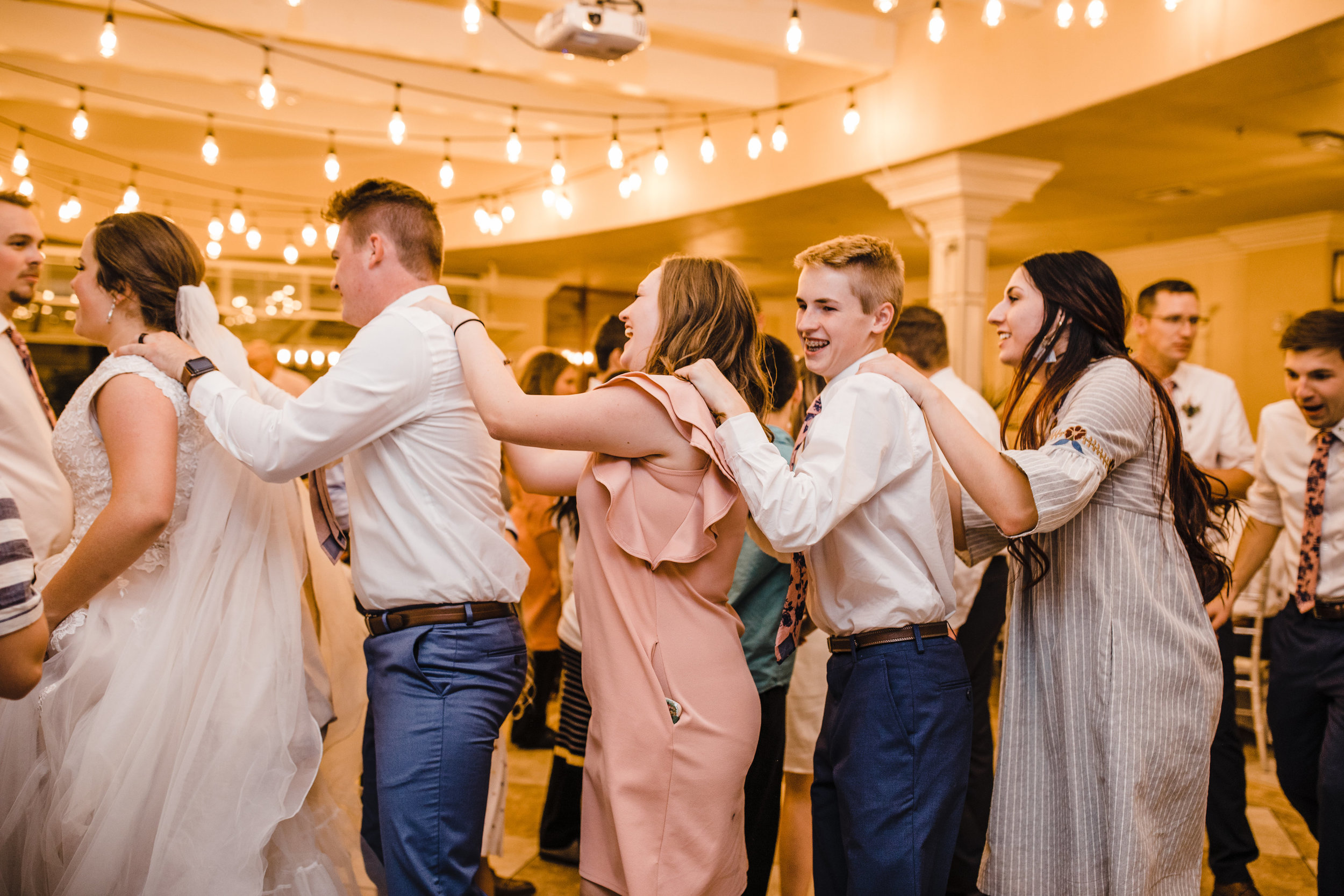 professional las vegas wedding photographer wedding reception dance line shoulders happy laughing