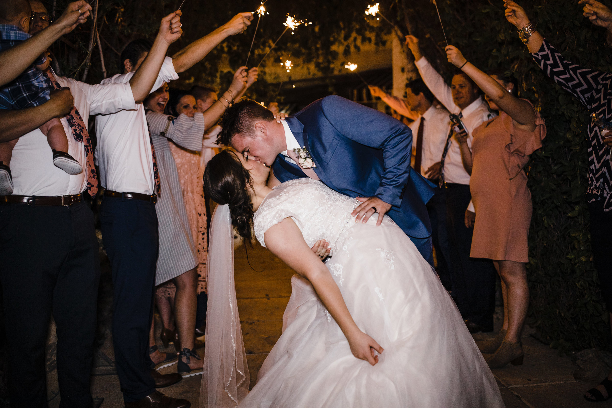 professional las vegas wedding photographer wedding reception exit sparklers arch dipping kissing romantic