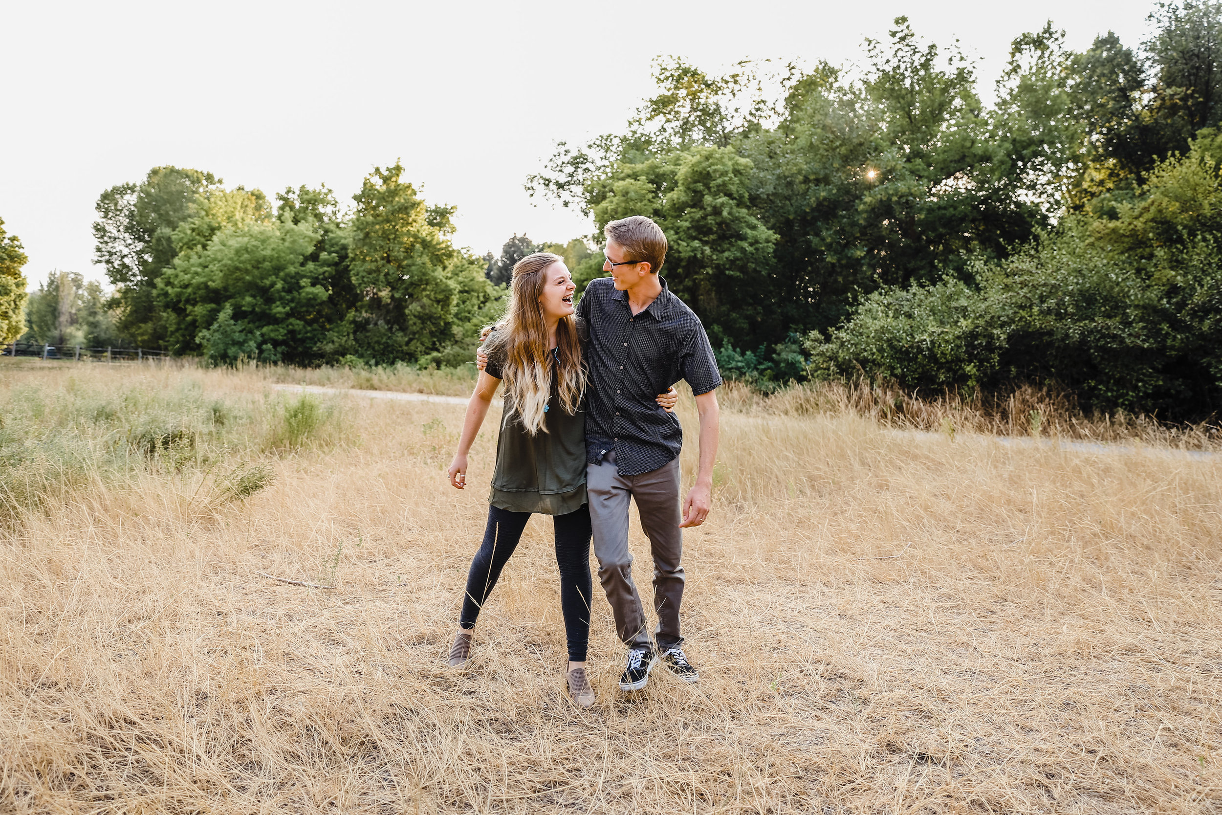best couples photographer logan utah running hugging walking laughing playful