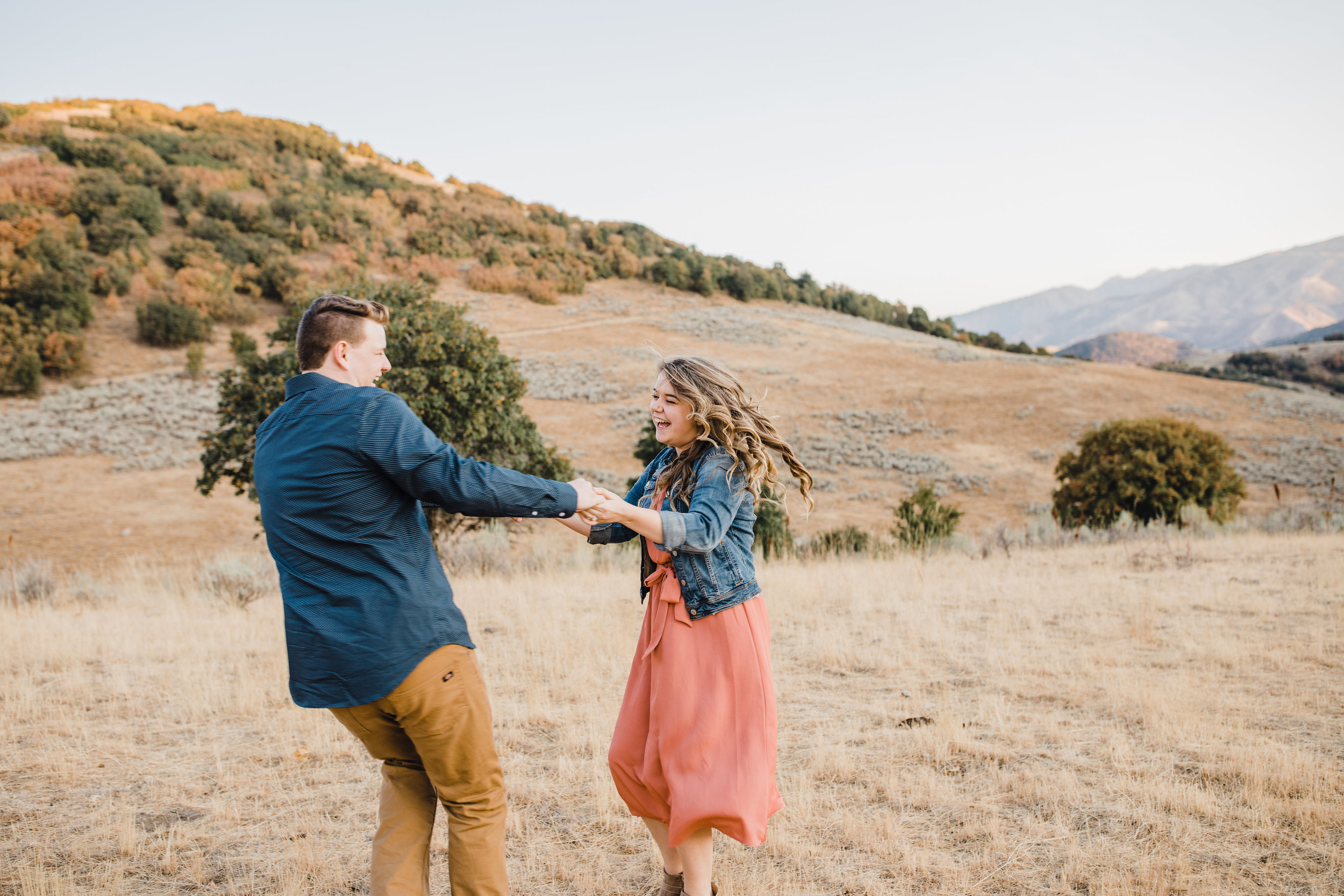 best professional cache valley engagement photographer dancing laughing playful mountains flying curls
