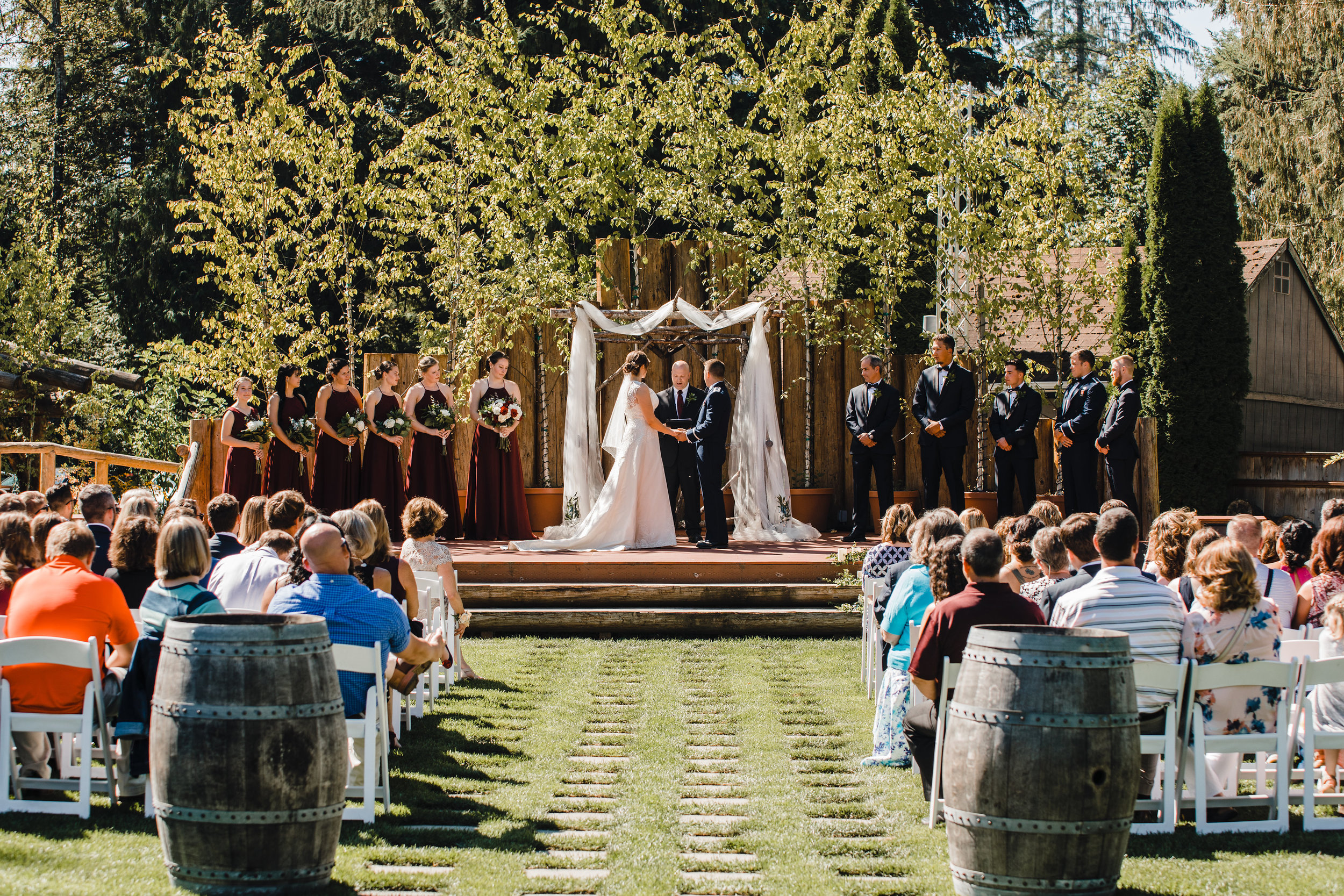 olympia washington wedding photographer outdoor wedding organza wedding arch grass stones isle