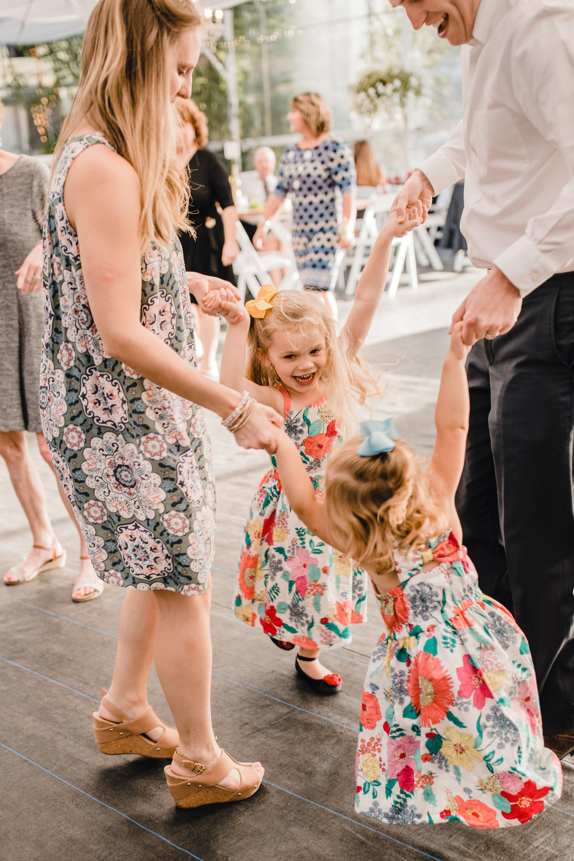 professional wedding photographer olympia washington wedding reception dancing kids holding hands smiling