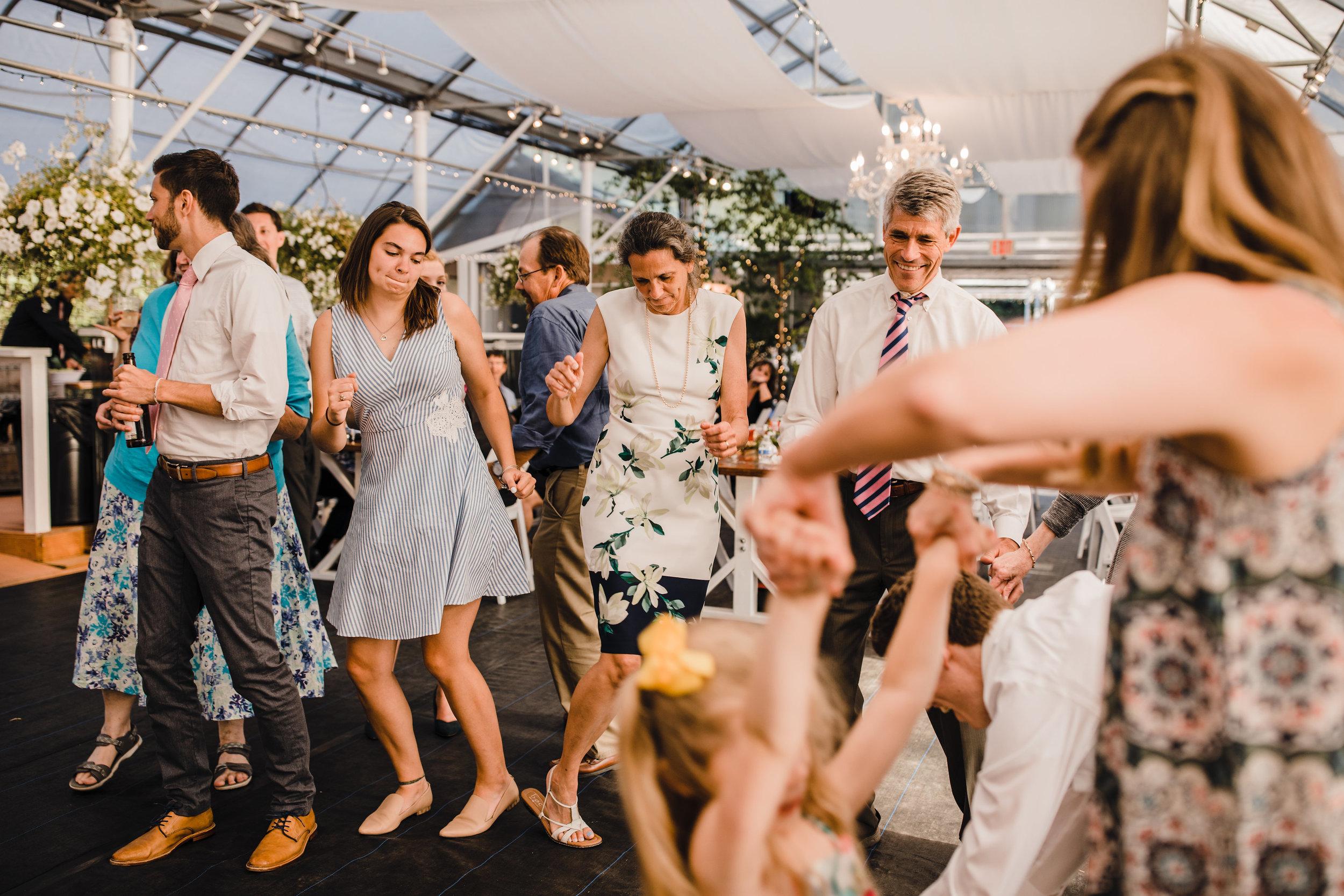 olympia washington wedding photographer dancing reception happy tent