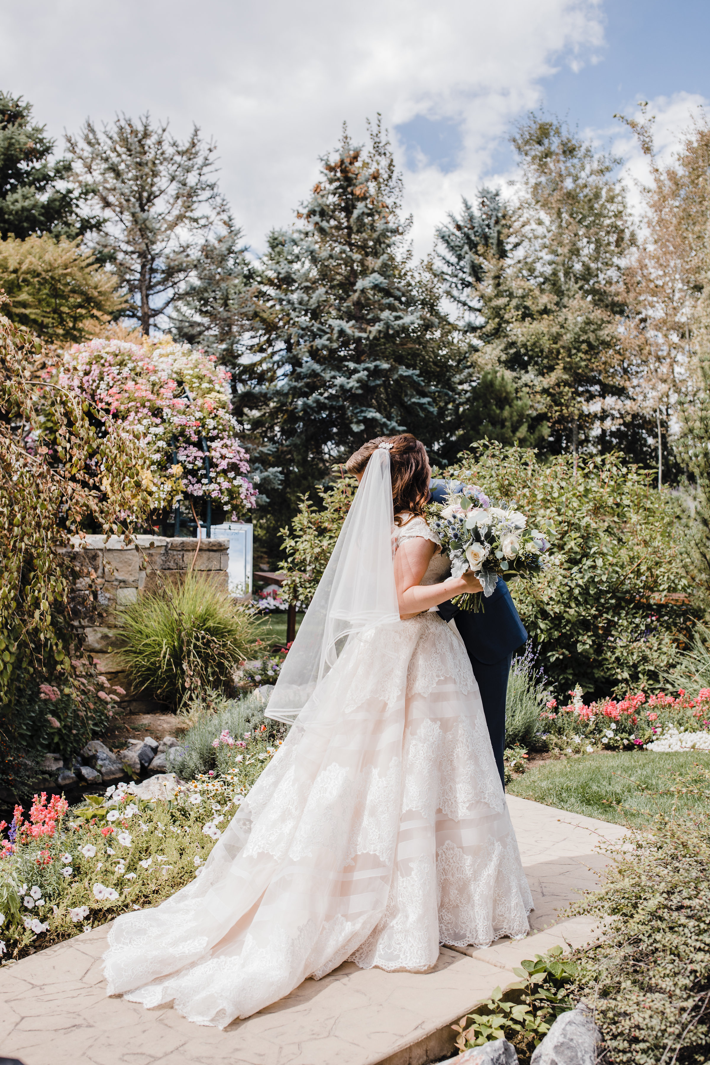 provo utah wedding photographer best first look hugging kissing romantic lace garden