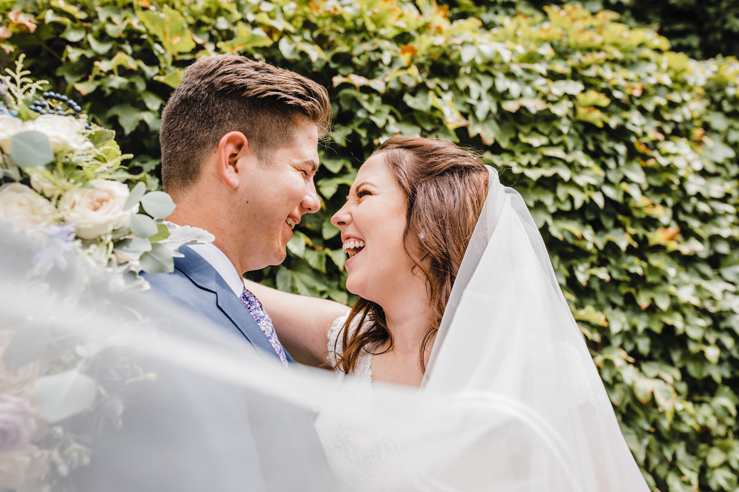 professional provo utah wedding photographer billowing veil laughing romantic playful ivy backdrop