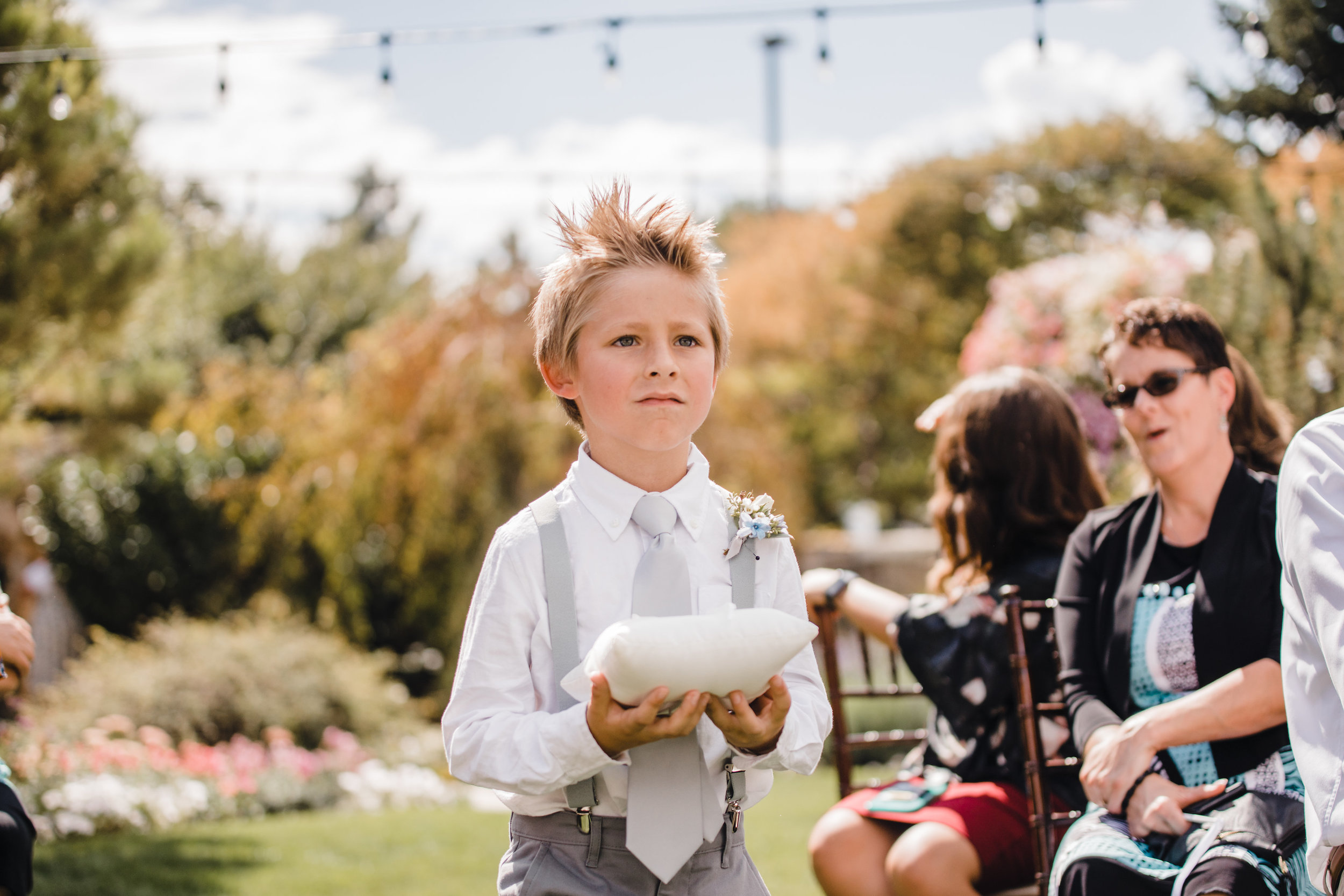 utah valley wedding photographer outdoor wedding ceremony ring bearer string lights