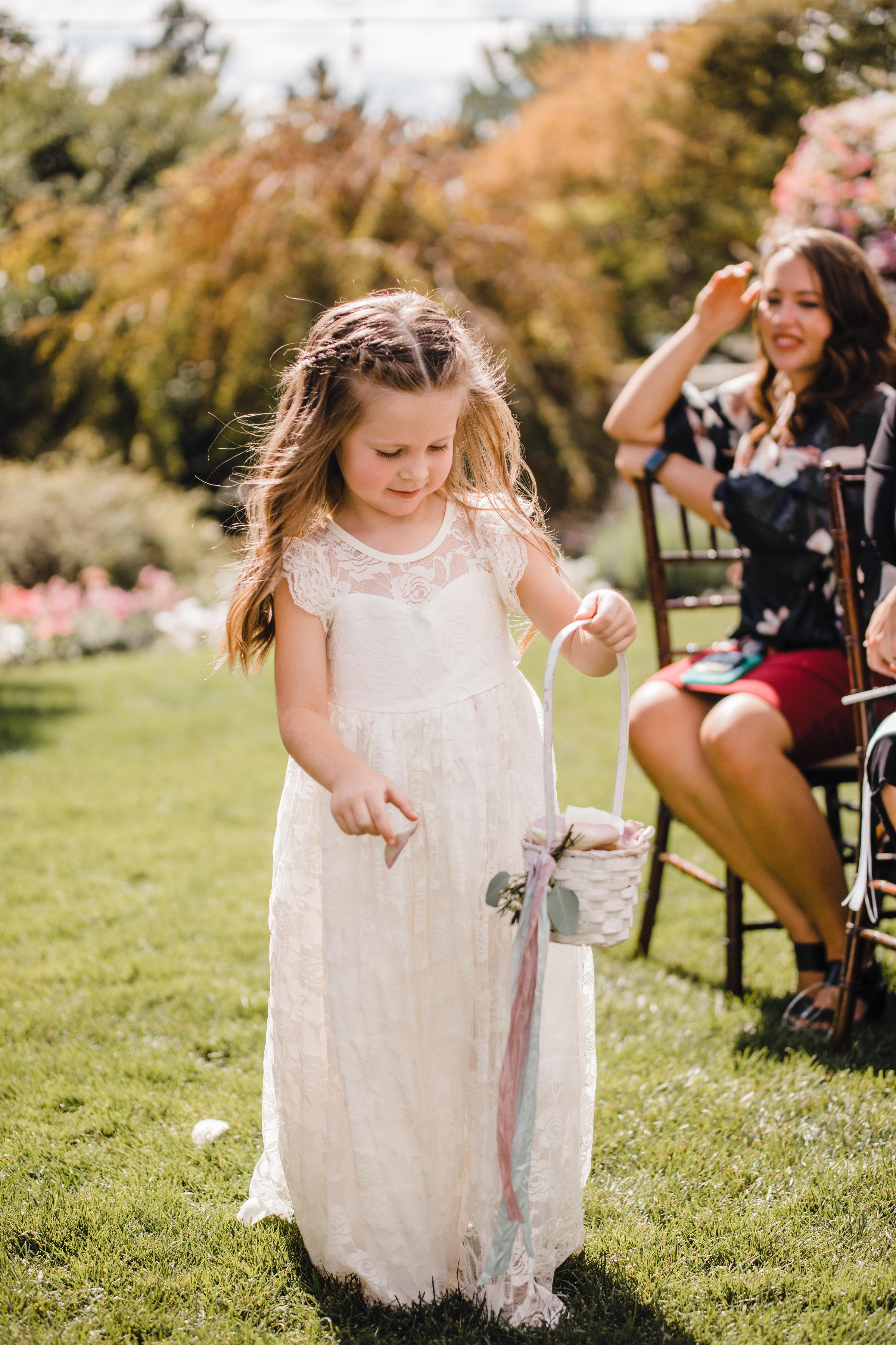 provo utah wedding photographer flower girl outdoor ceremony isle rose petals