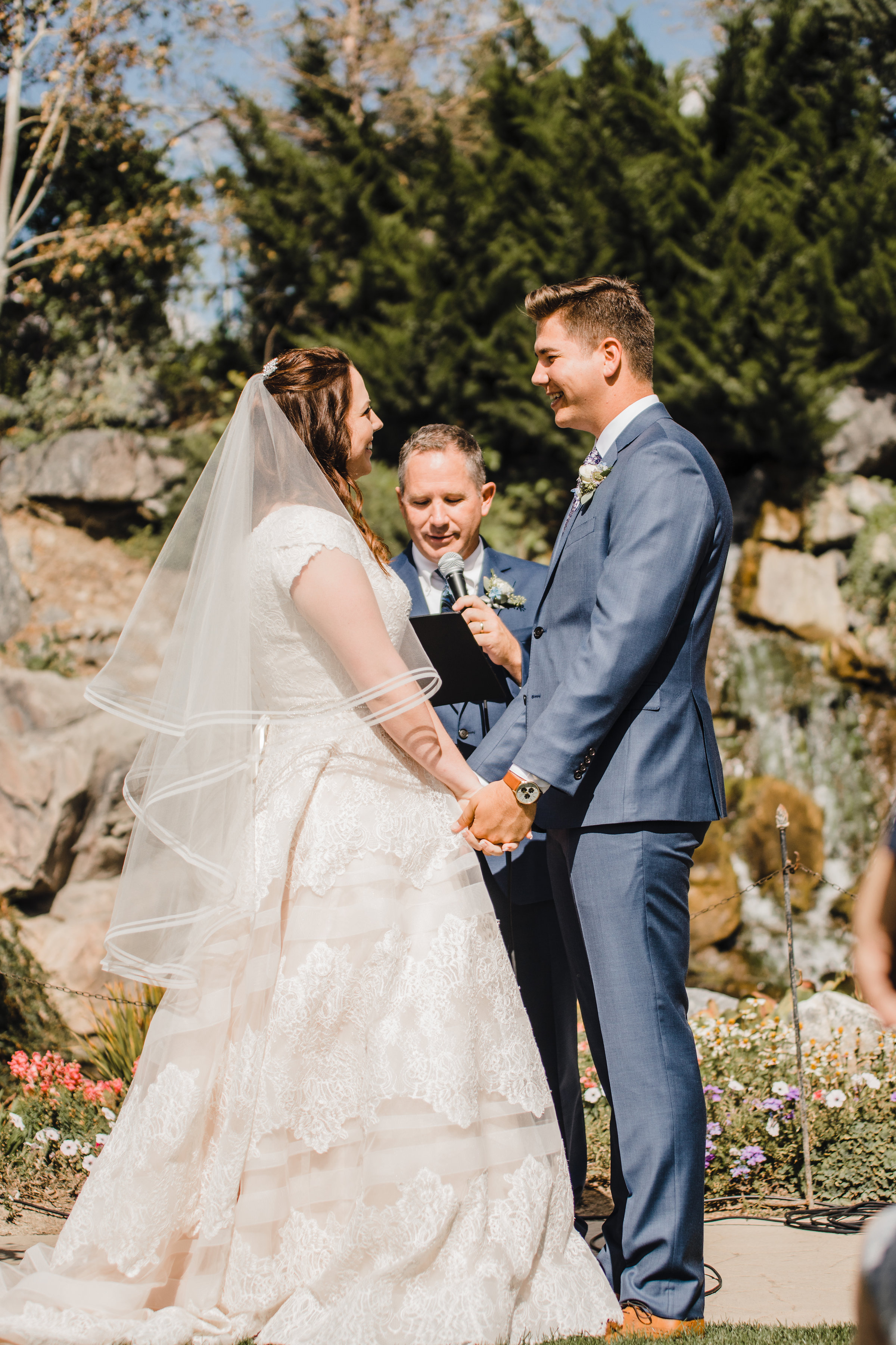 professional wedding photographer utah valley outdoor wedding ceremony holding hands