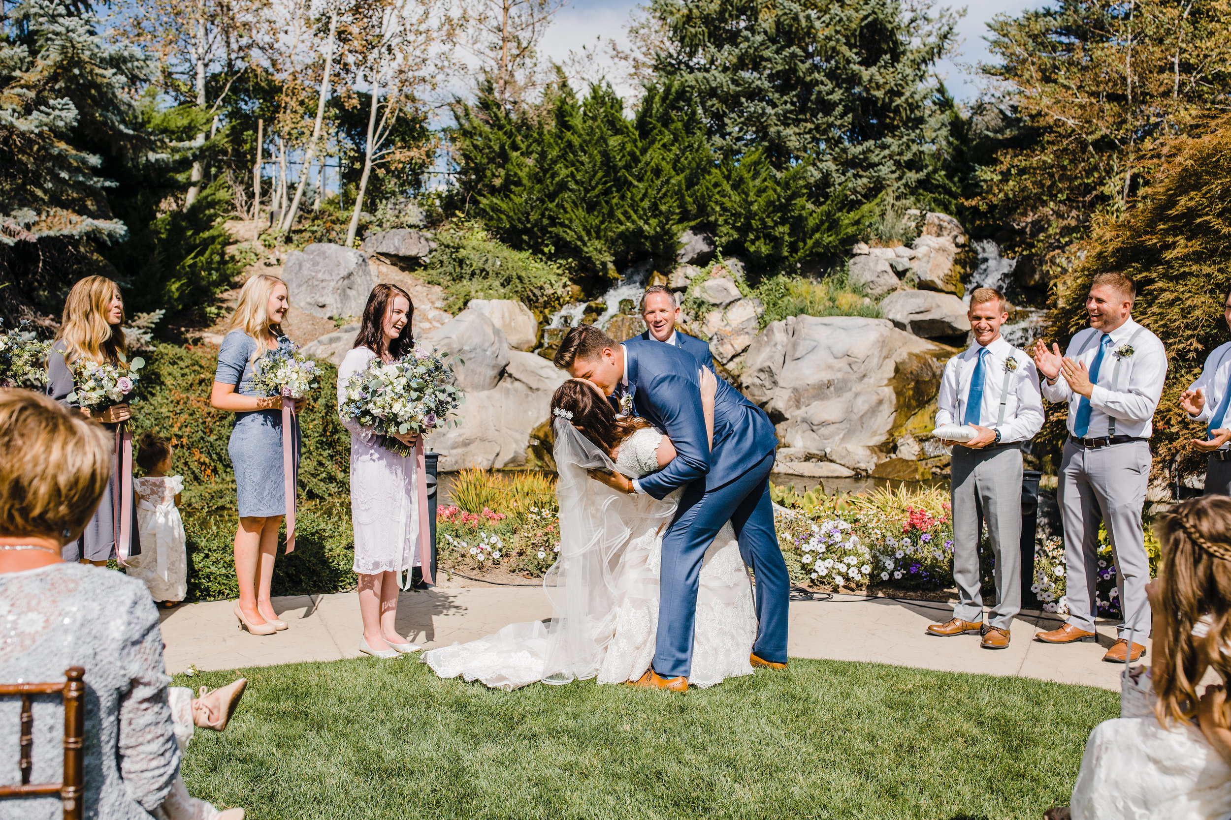 professional utah valley photographer outdoor wedding ceremony kissing dip romantic cheering