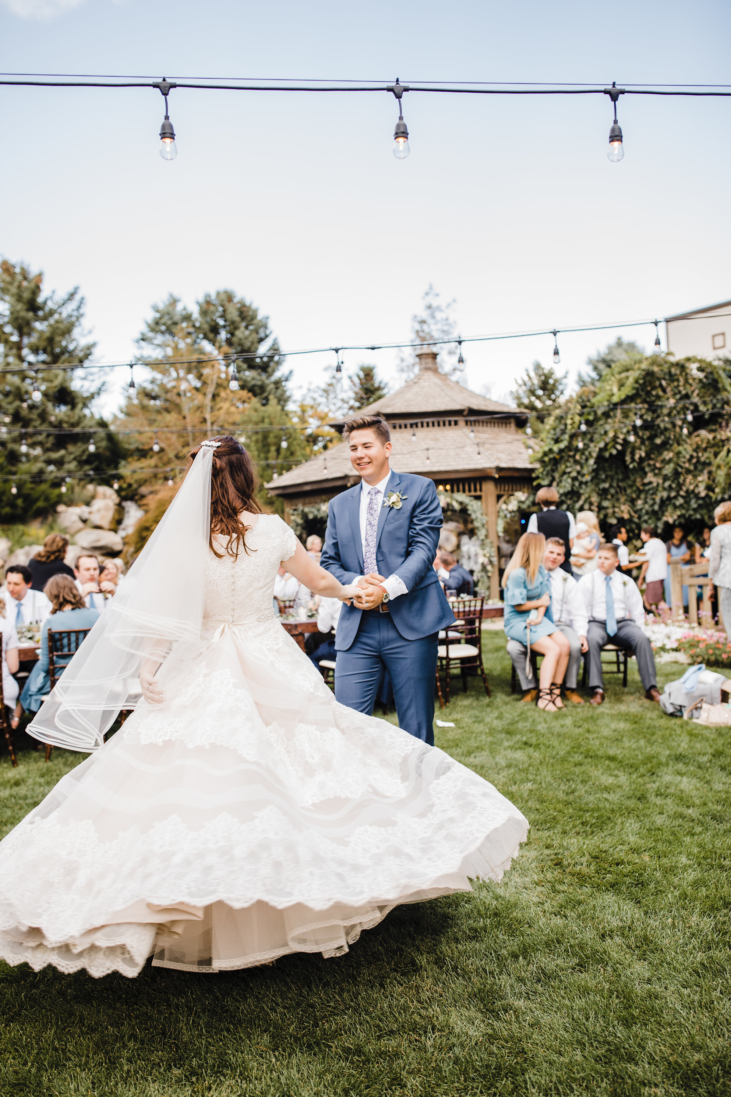 best provo utah wedding photographer first dance outdoor ceremony twirl spin string lights