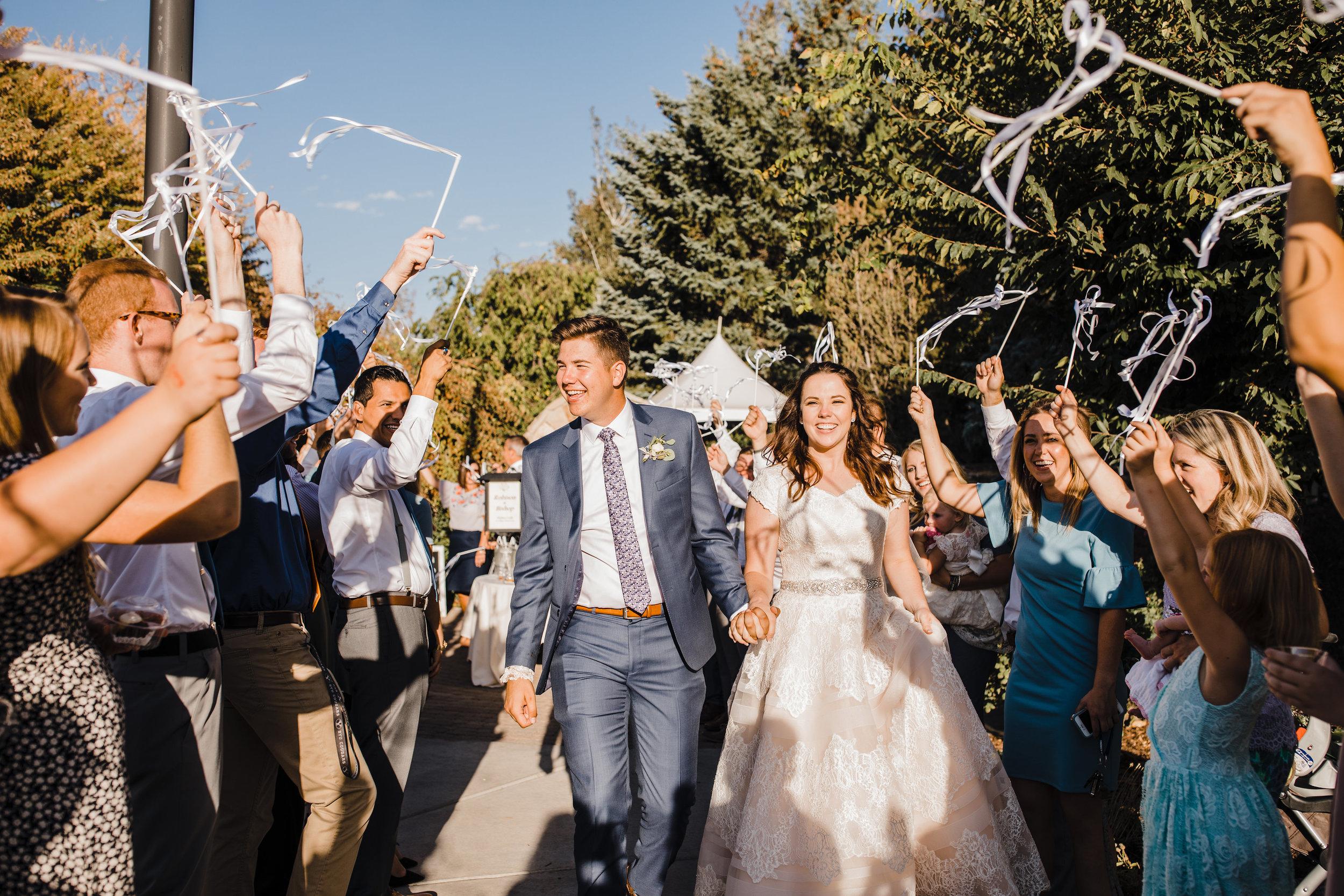 provo utah wedding photographer wedding exit streamers cheering happy
