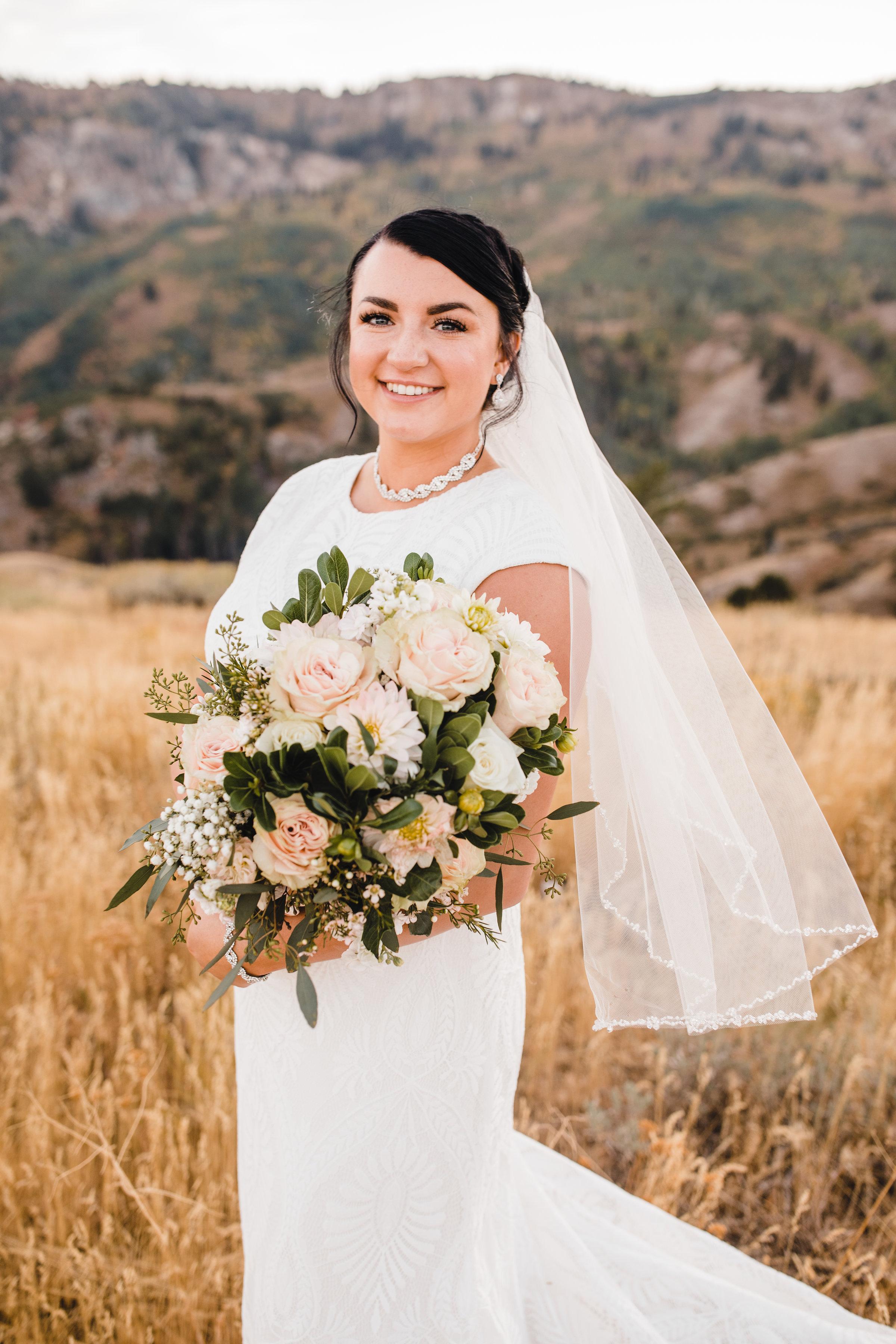 best formal photographer logan utah bride pink bouquet diamond necklace