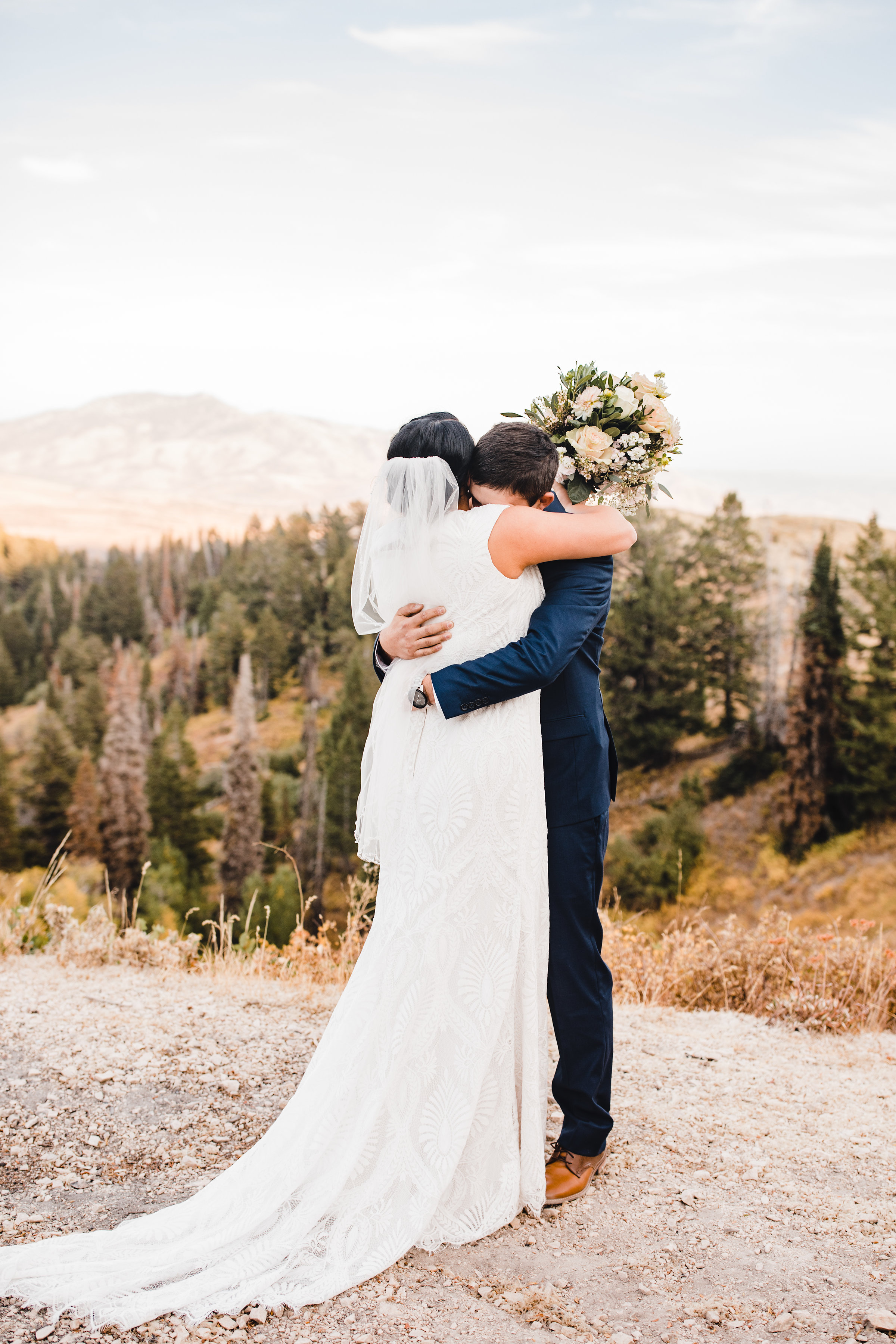 best formal photographer cache valley utah hugging first look happy blush bouquet