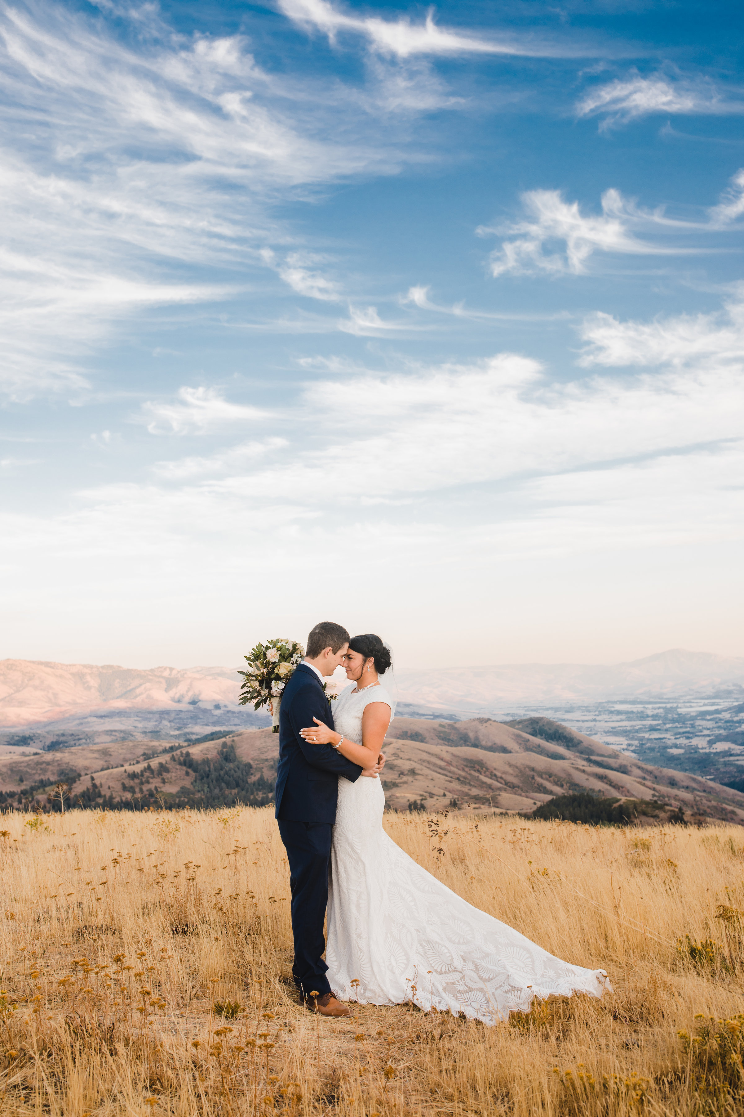 best formal photographer blue paintbrush sky mountain backdrop hugging romantic