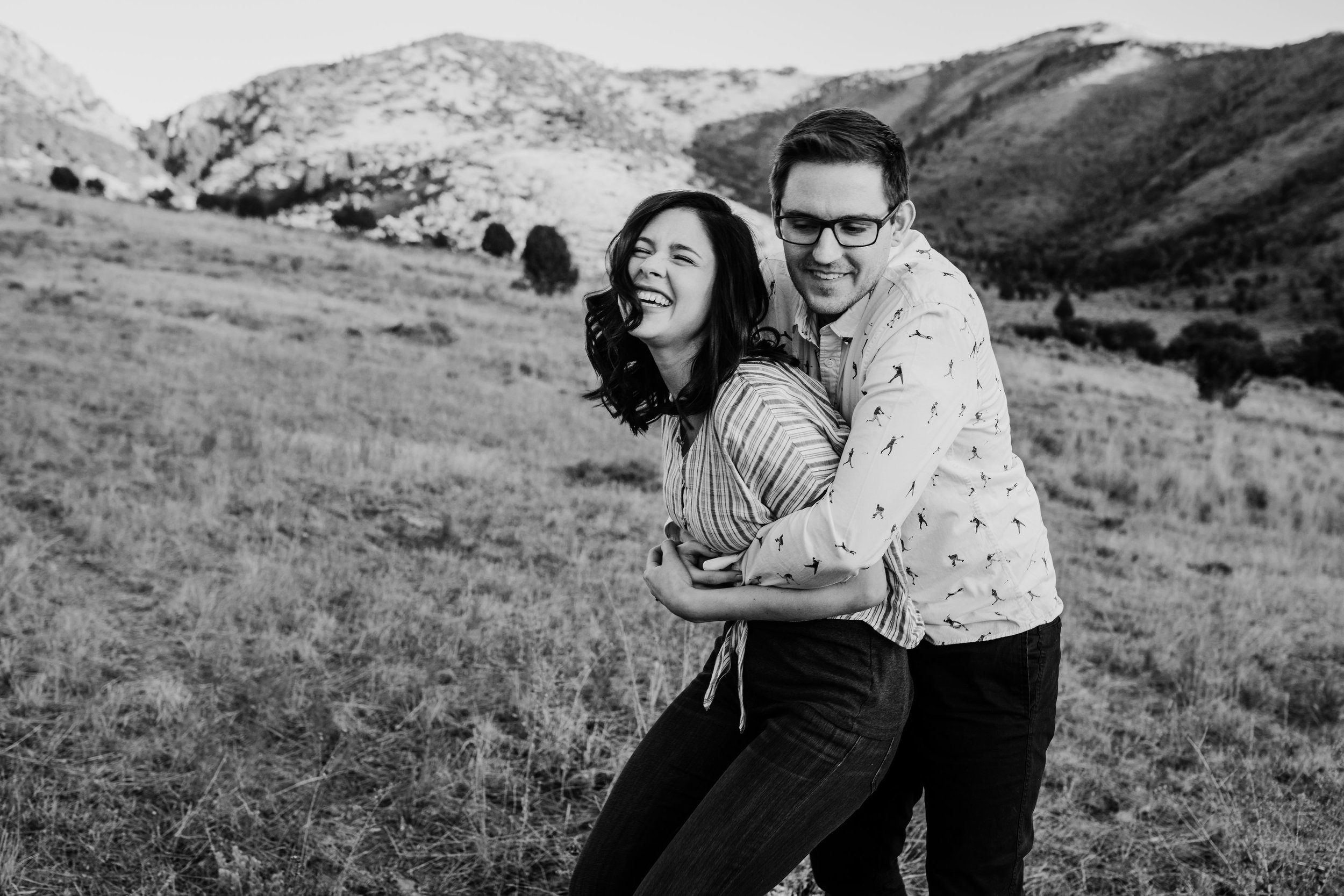 best professional engagement photographer logan utah mountaing hugging running playful smiling laughing